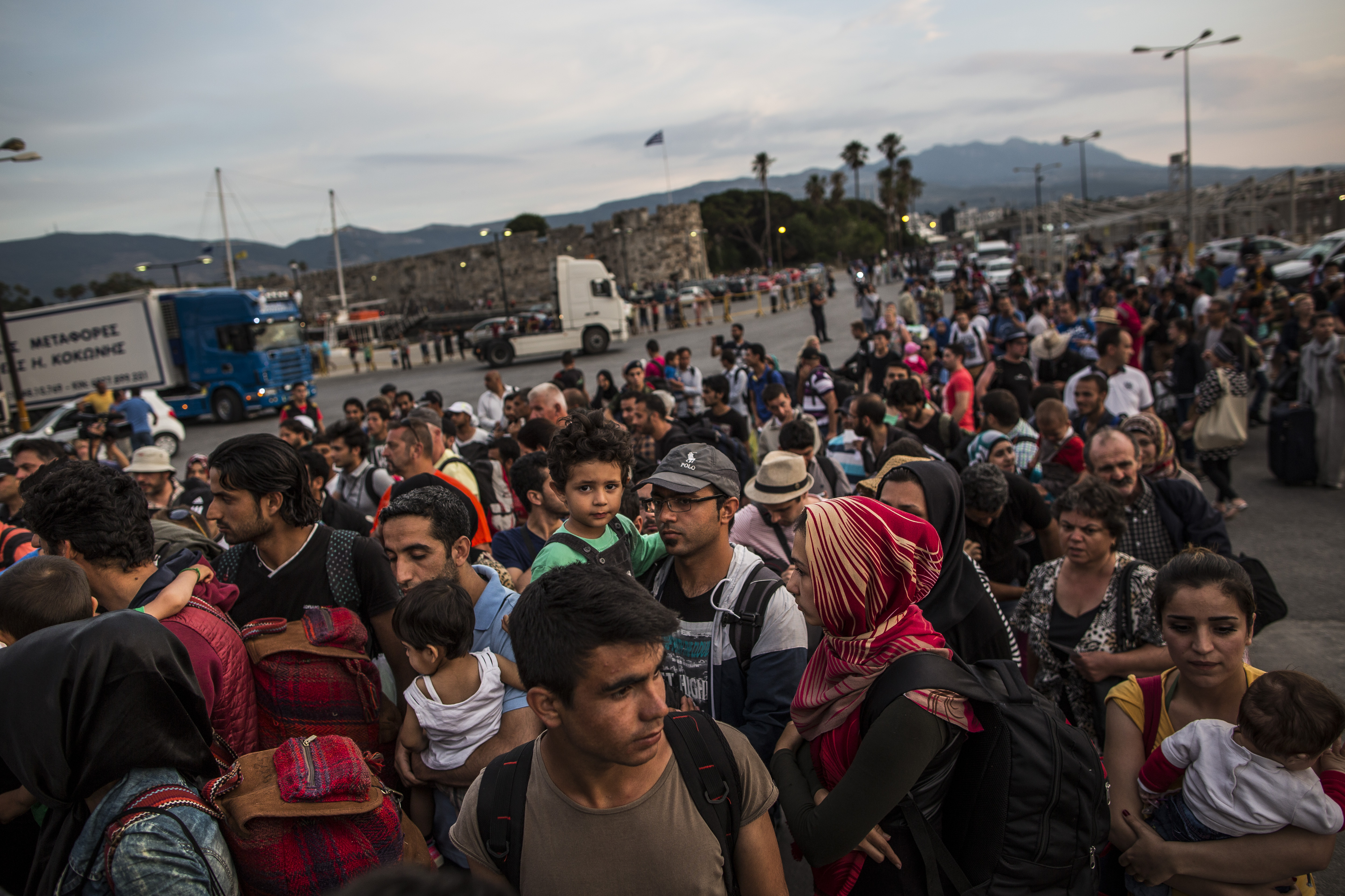 Hundreds of migrant men, women and children along with tourists and locals board a ferry bound for Athens on June 04, 2015 in Kos, Greece.