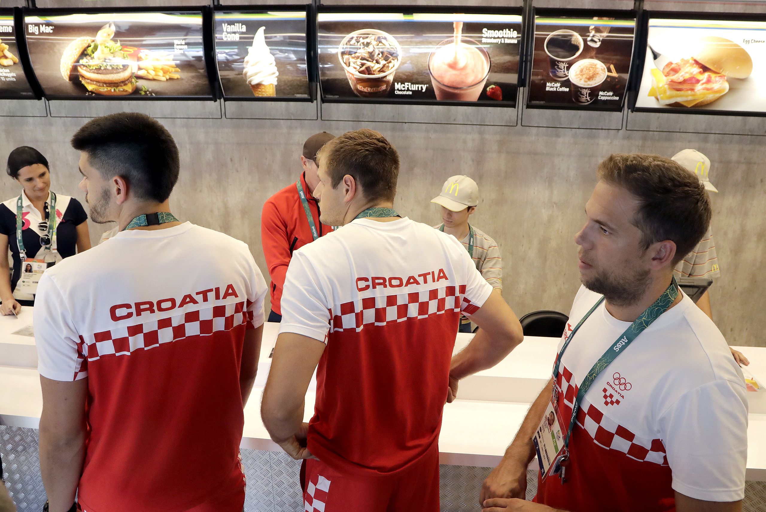 Members of the Croatian handball team wait for their meal at a McDonalds in the Olympic athletes village in Rio de Janeiro, Brazil, July 30, 2016.
