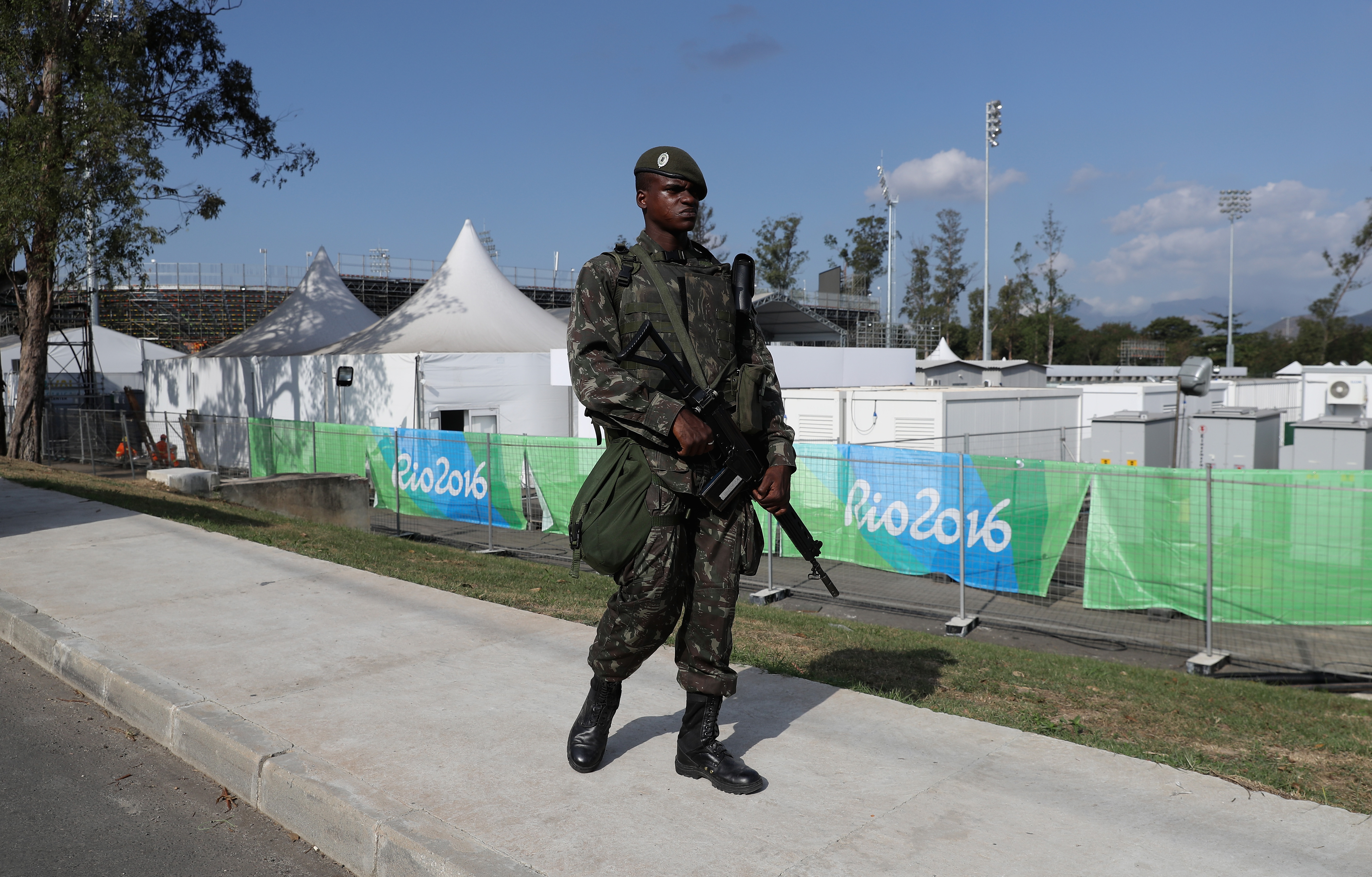A soldier patrols the perimeter fence around the Deodora Olympic sports complex during the build up to the Rio Olympic Games on July 30, 2016 in Rio de Janeiro.