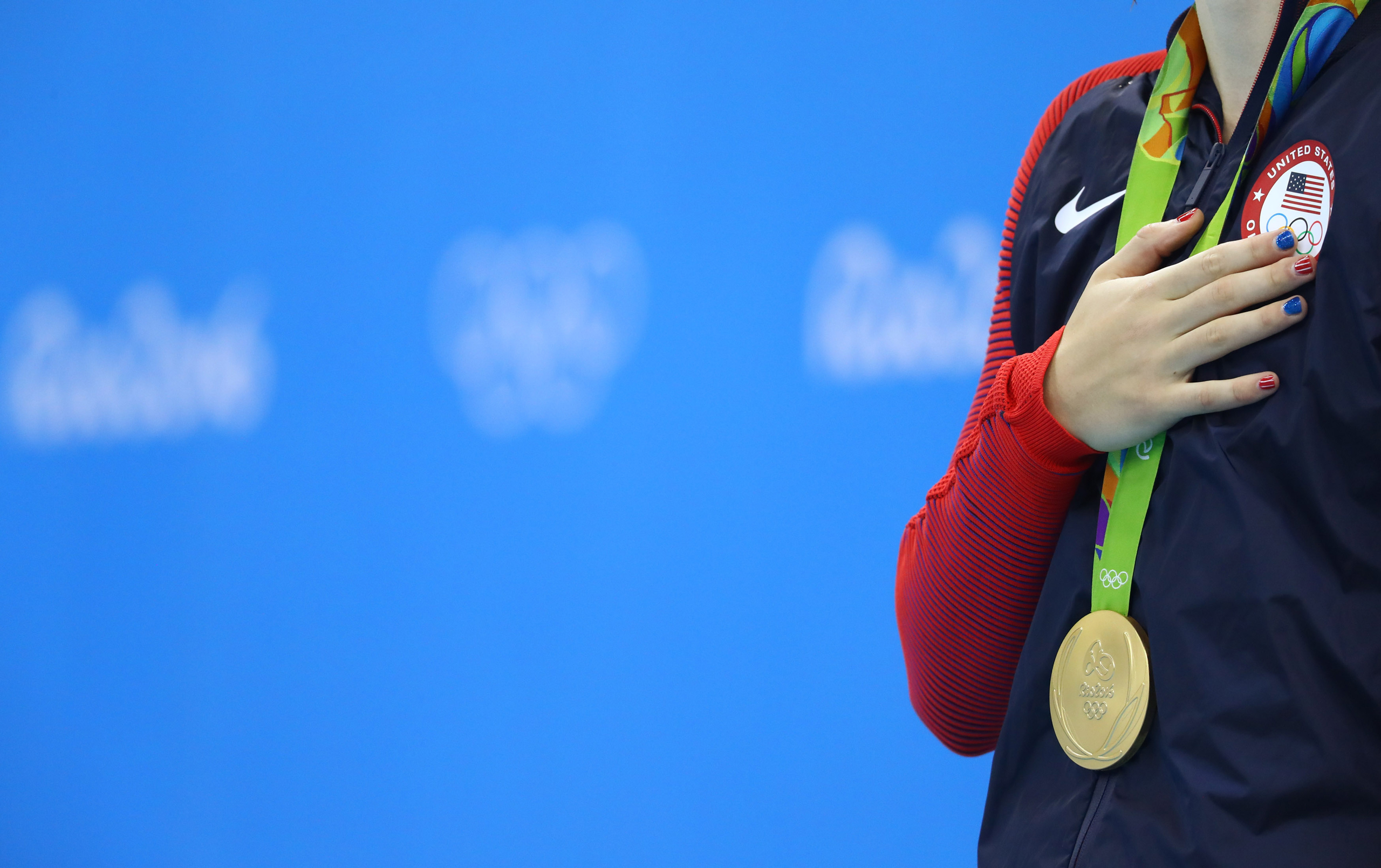 Katie Ledecky of USA stands to attention during the national anthem after winning the gold medal in the Women's 200m Freestyle at the 2016 Rio Olympics in Rio de Janeiro on Aug. 9, 2016.