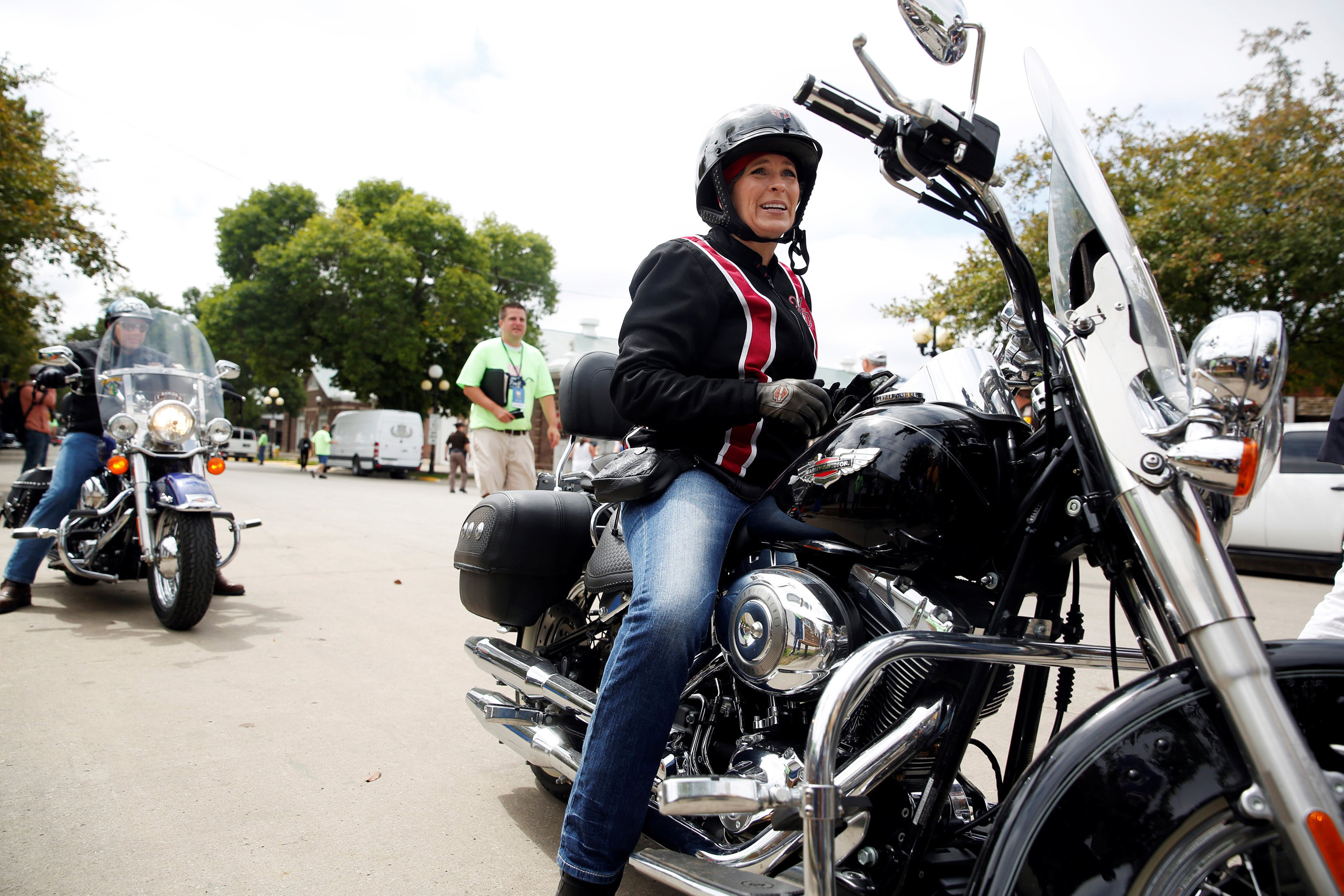 Iowa Senator Joni Ernst arrives via motorcycle to her annual Roast and Ride at the Iowa State Fairgrounds in Des Moines Aug. 27, 2016.