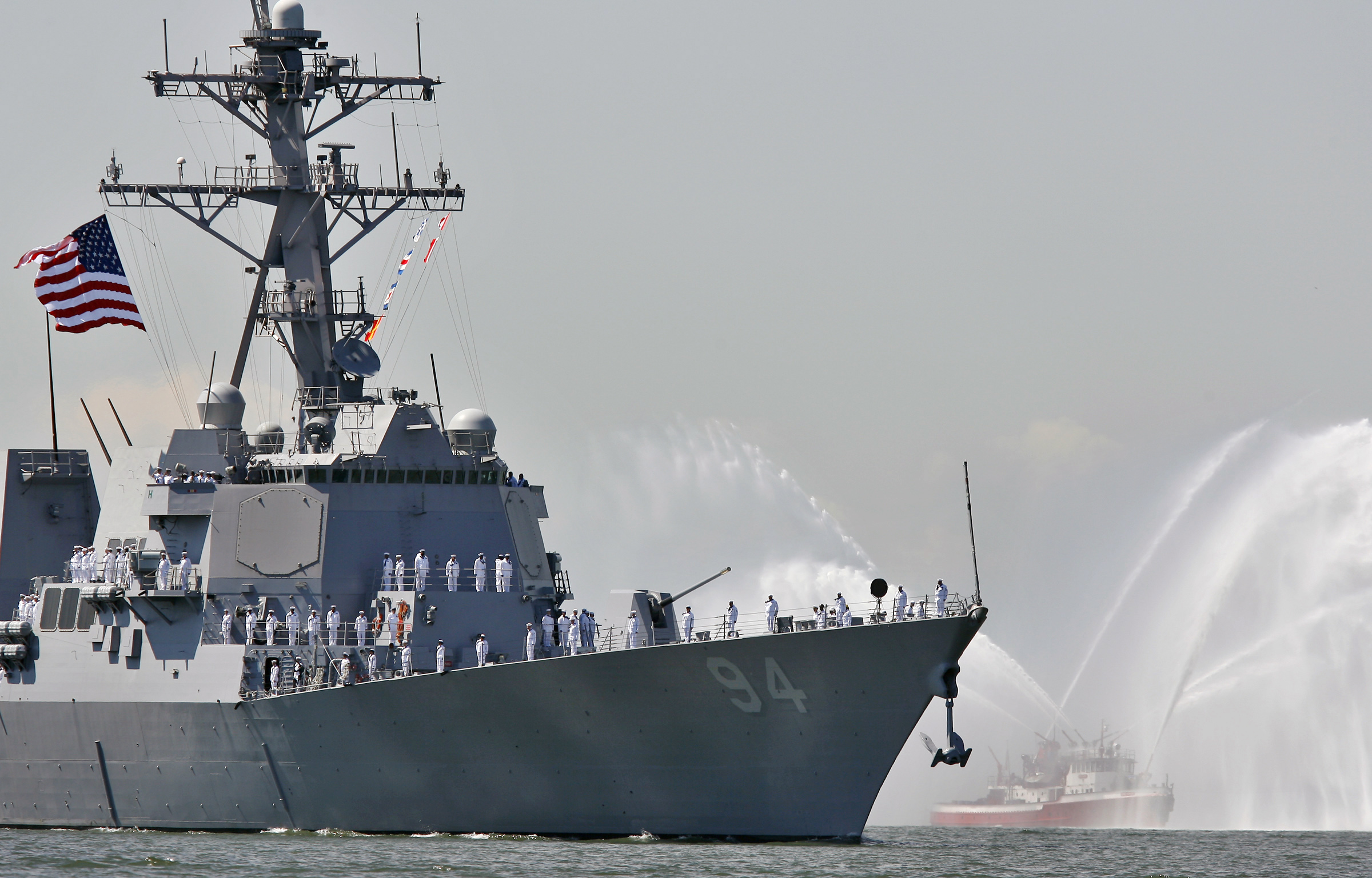 The U.S.S. Nitze is greeted by the spray of a fireboat to kick off Fleet Week in New York Harbor on May 24, 2006