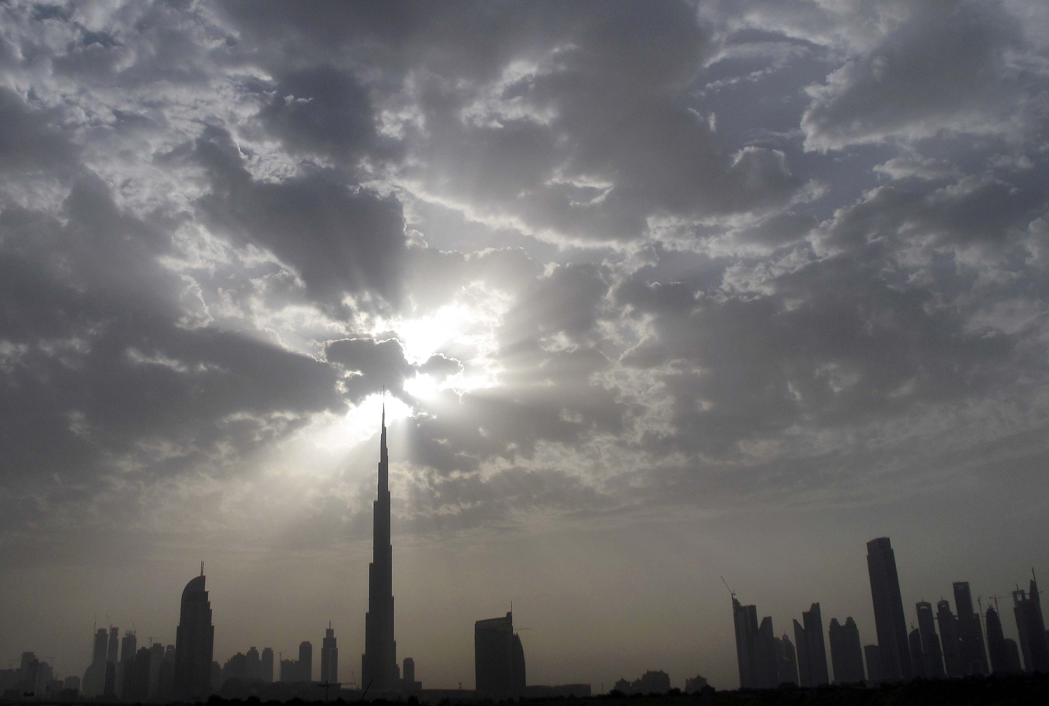 The Dubai skyline with Burj Khalifa (C) is seen during the late afternoon from the Sheikh Zayed highway March 28, 2010.