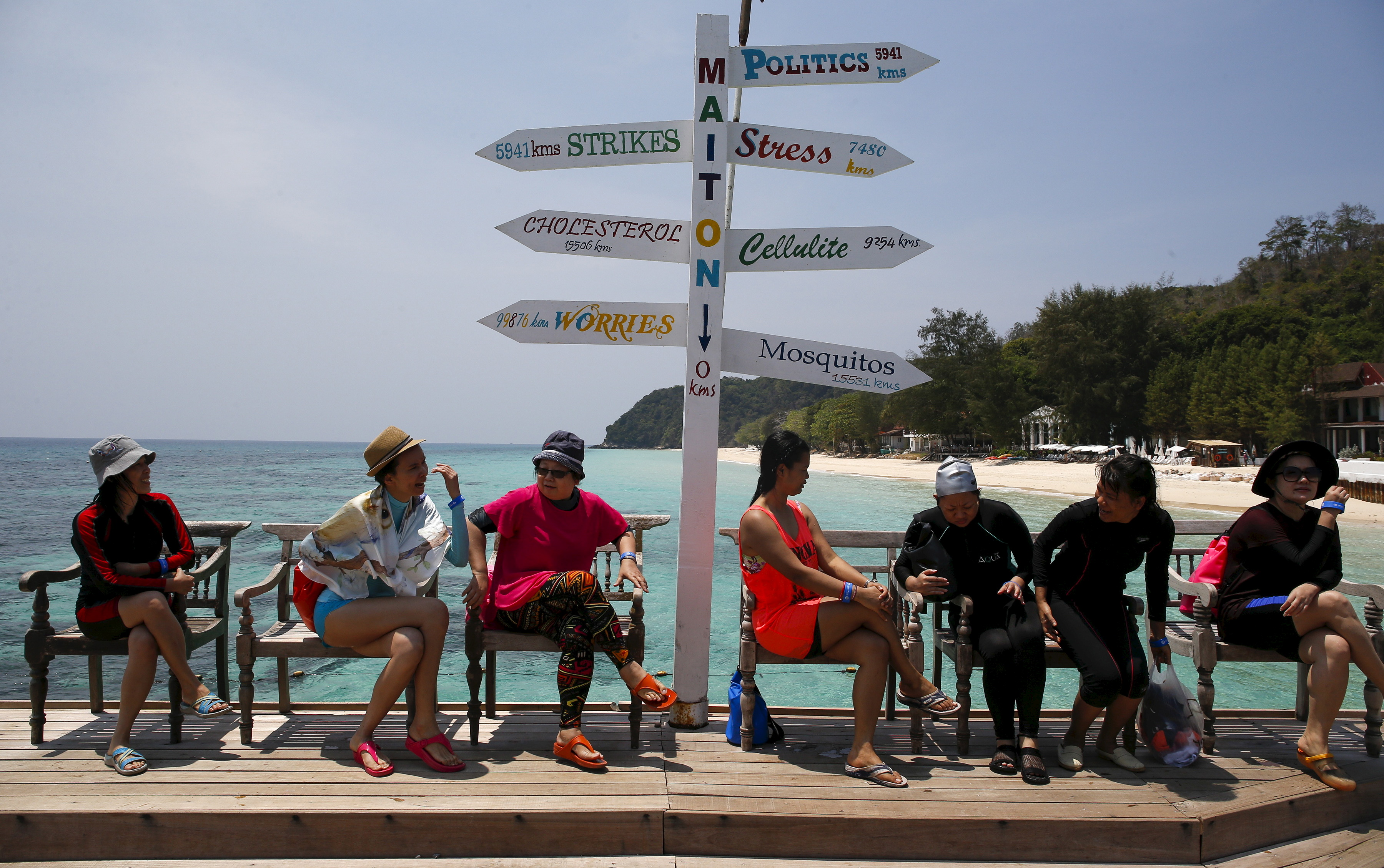 Tourists sit as they wait for their boat at Maiton Island in Phuket, Thailand, on March 18, 2016