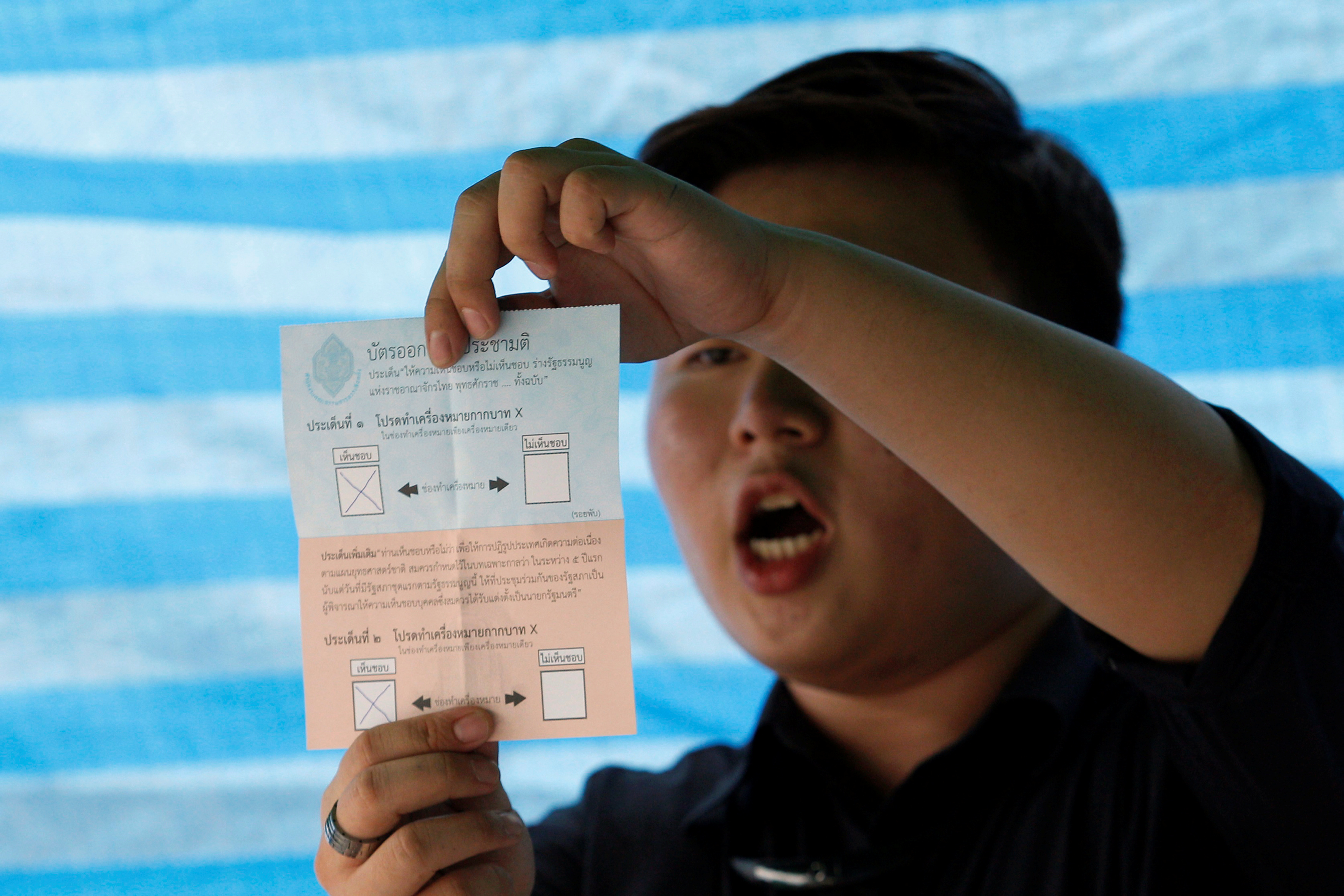A Thai electoral worker starts counting ballots at a polling station in Bangkok during a constitutional referendum vote on Aug. 7, 2016