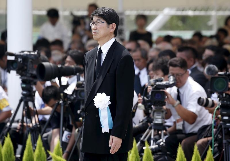 Nagasaki Mayor Tomihisa Taue walks to deliver his speech during a ceremony commemorating the 70th anniversary of the 1945 atomic bombing of the city at Nagasaki's Peace Park in Nagasaki, western Japan, August 9, 2015