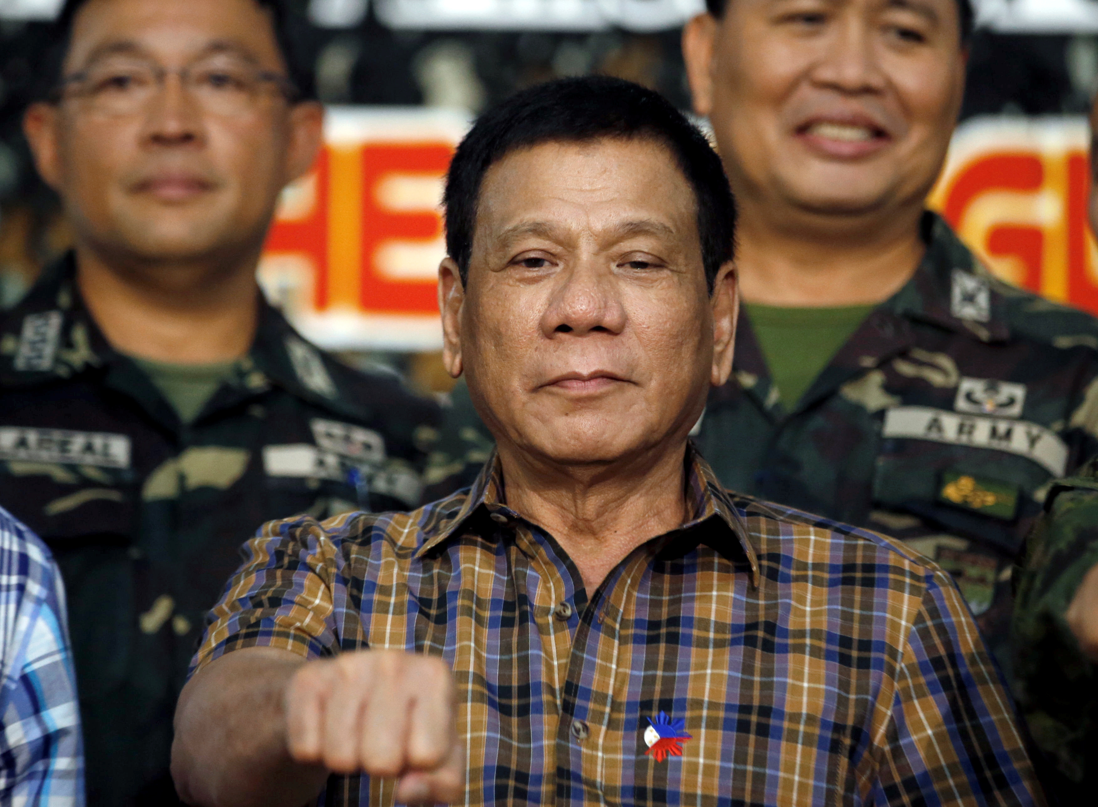 Philippine President Rodrigo Duterte gestures at soldiers during a visit at Capinpin military camp in Tanay, in the Philippine province of Rizal, on Aug. 24, 2016