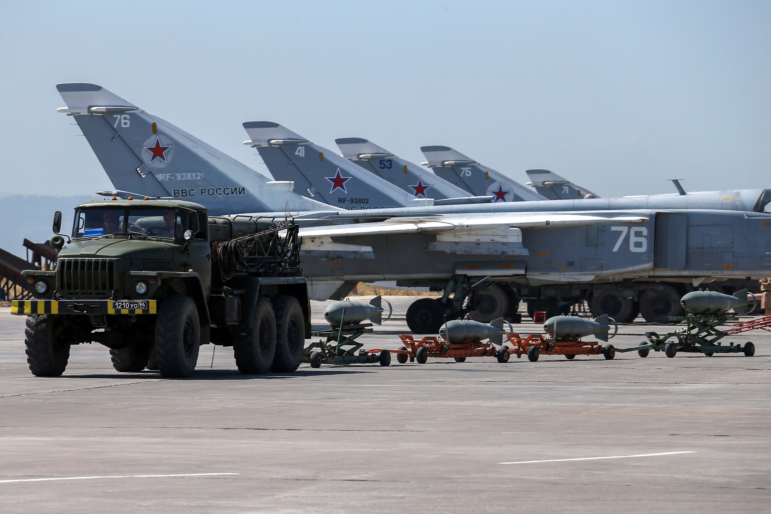 Russian fighter jets and bombers are parked at Hemeimeem air base in Syria on June 18, 2016.