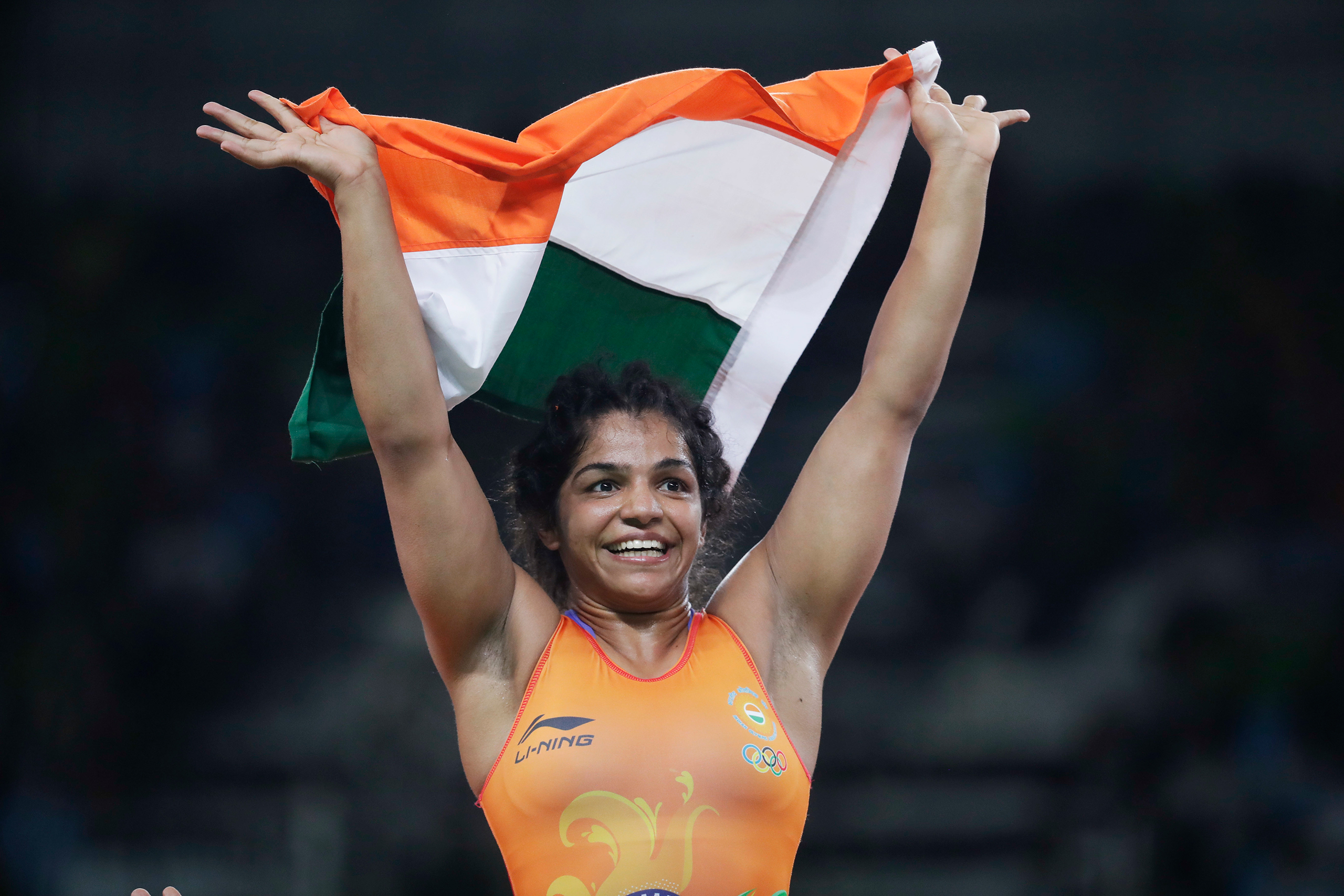 India's Sakshi Malik reacts after winning bronze against Kyrgyzstan's Aisuluu Tynybekova in the women's wrestling freestyle 58-kg competition at the 2016 Summer Olympics in Rio de Janeiro on Aug. 17, 2016.