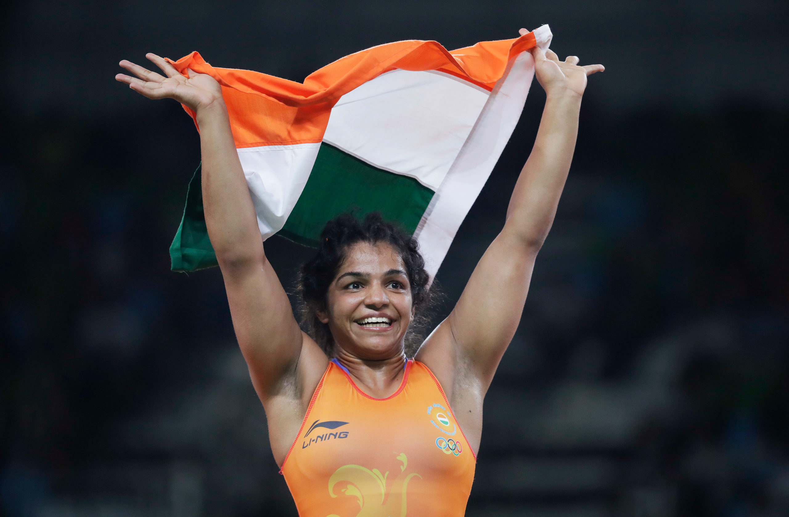 India's Sakshi Malik reacts after winning bronze against Kyrgyzstan's Aisuluu Tynybekova in the women's wrestling freestyle 58-kg competition at the Summer Olympics in Rio de Janeiro on Aug. 17, 2016