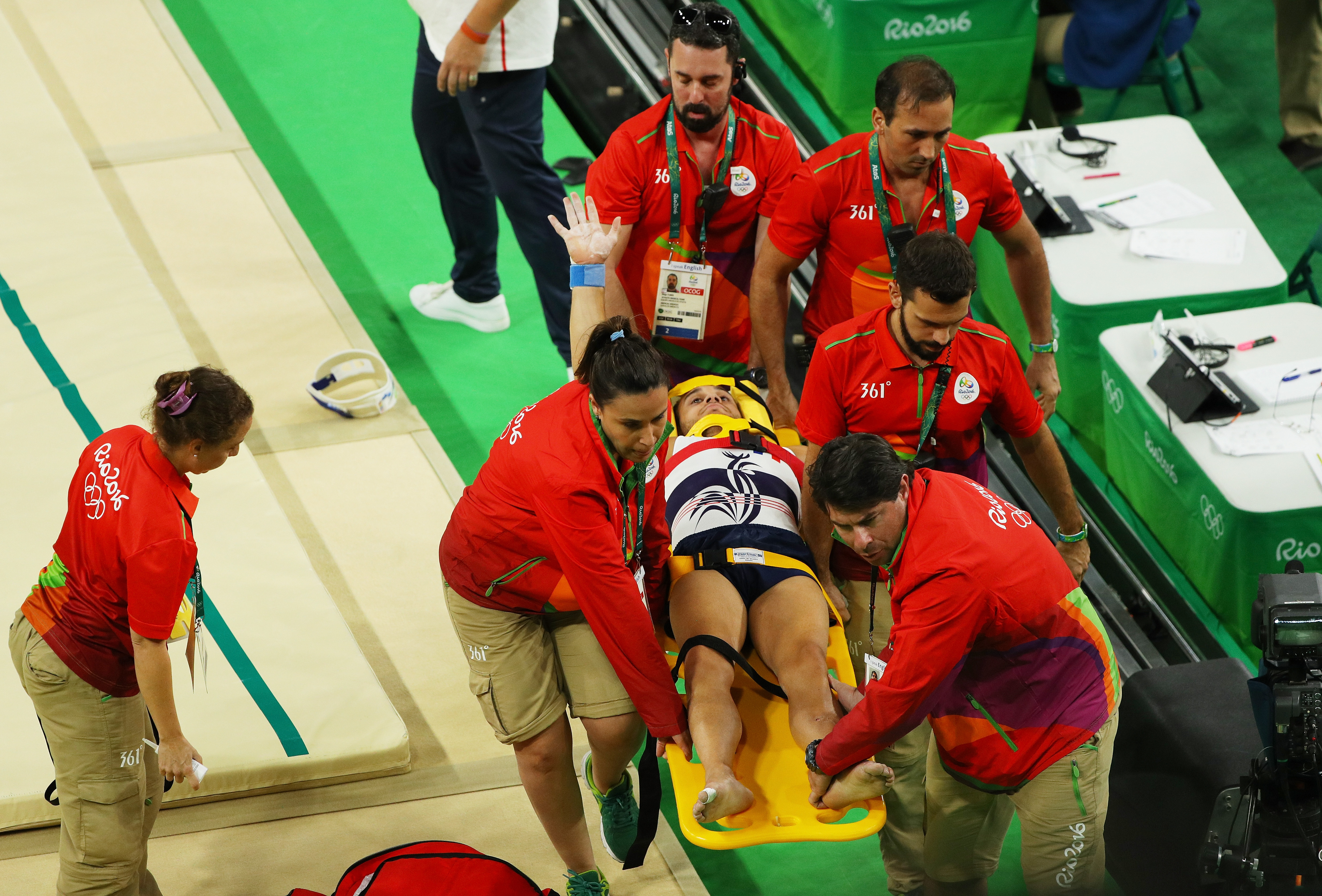 Samir Ait Said of France receives medical attention during the Gymnastics Men's Team qualification on Day 1 of the Rio 2016 Olympic Games on August 6, 2016.