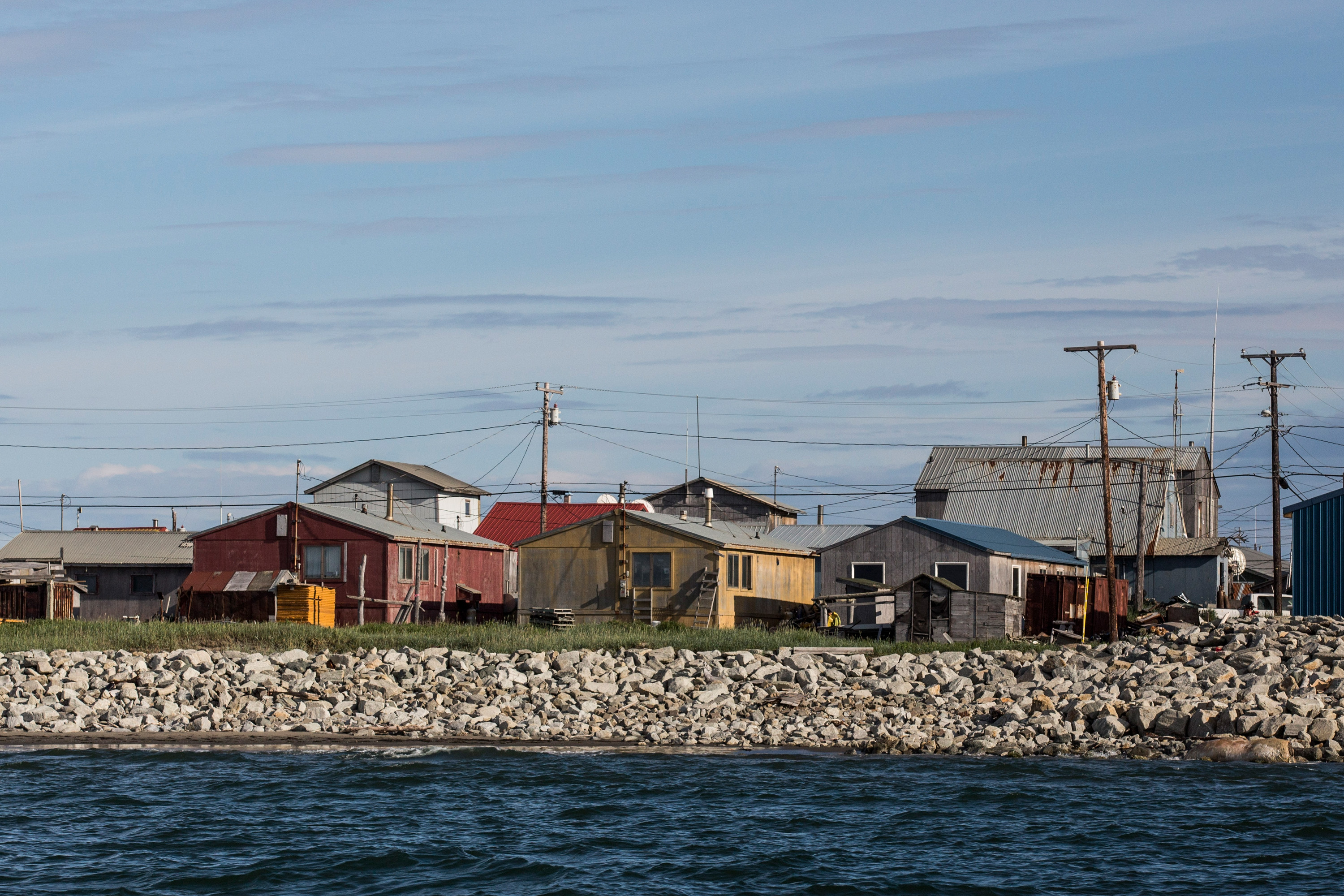 The village of Shishmaref, Alaska, which sits upon the Chukchi sea, is seen on July 9, 2015.