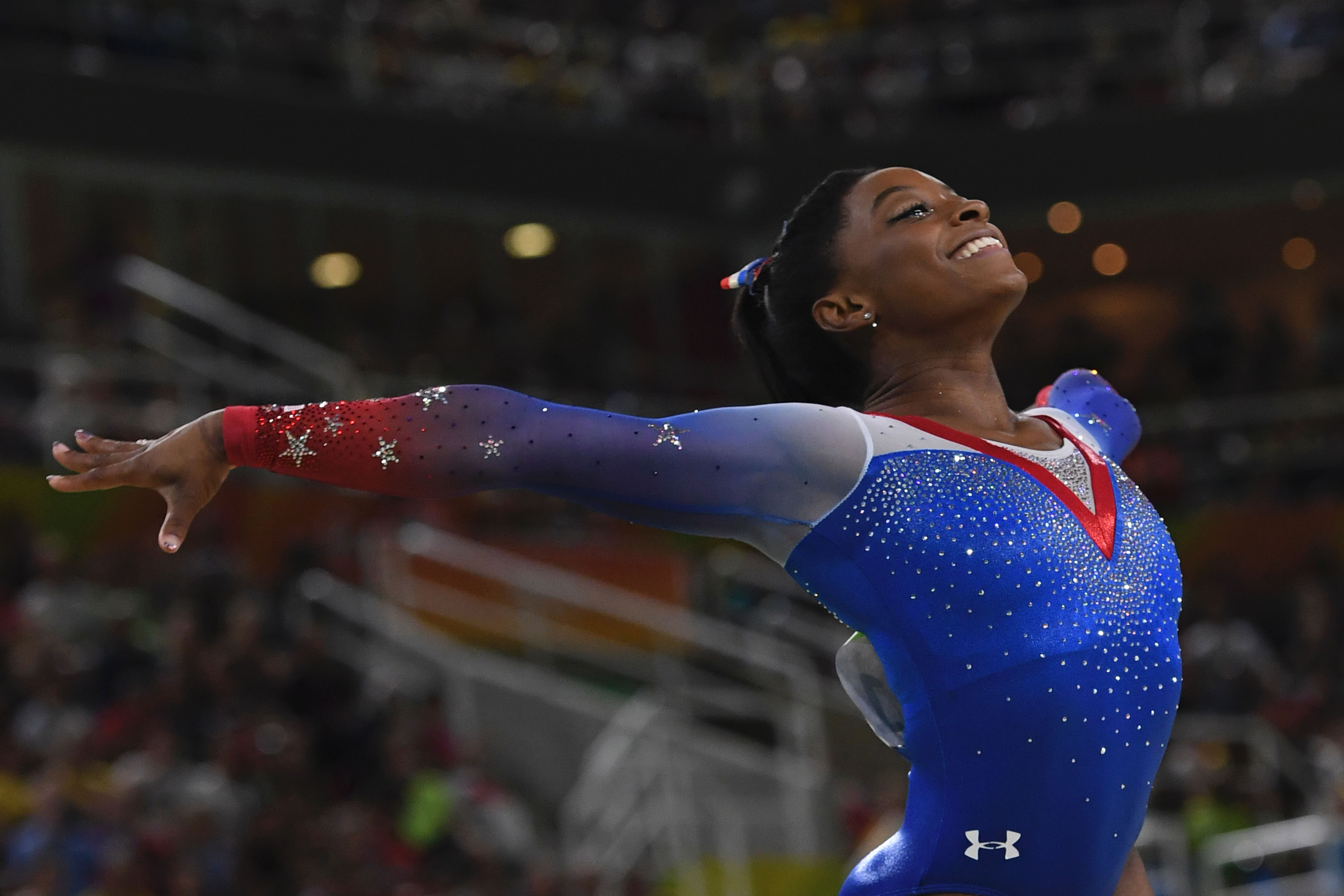 U.S. gymnast Simone Biles competes in the women's floor event final of the Artistic Gymnastics at the Olympic Arena during the Rio 2016 Olympic Games in Rio de Janeiro on August 16, 2016.