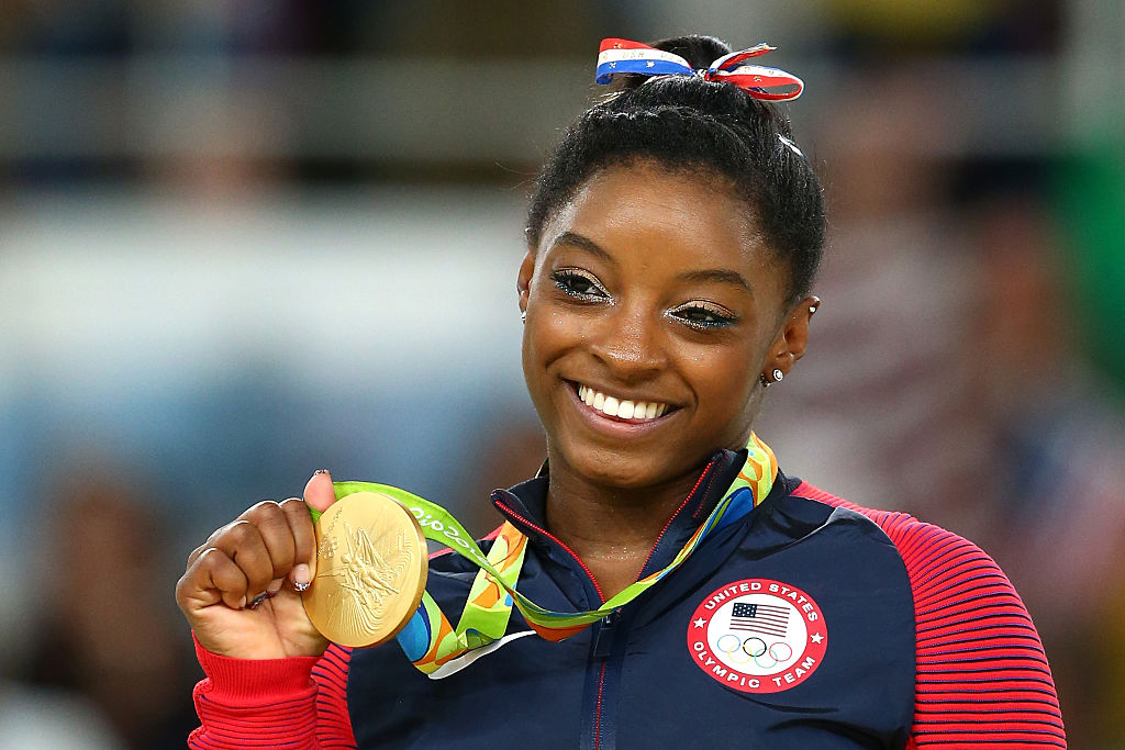 RIO DE JANEIRO, BRAZIL - AUGUST 16:  Gold medalist Simone Biles of the United States celebrates on the podium at the medal ceremony for the Women's Floor on Day 11 of the Rio 2016 Olympic Games at the Rio Olympic Arena on August 16, 2016 in Rio de Janeiro, Brazil.