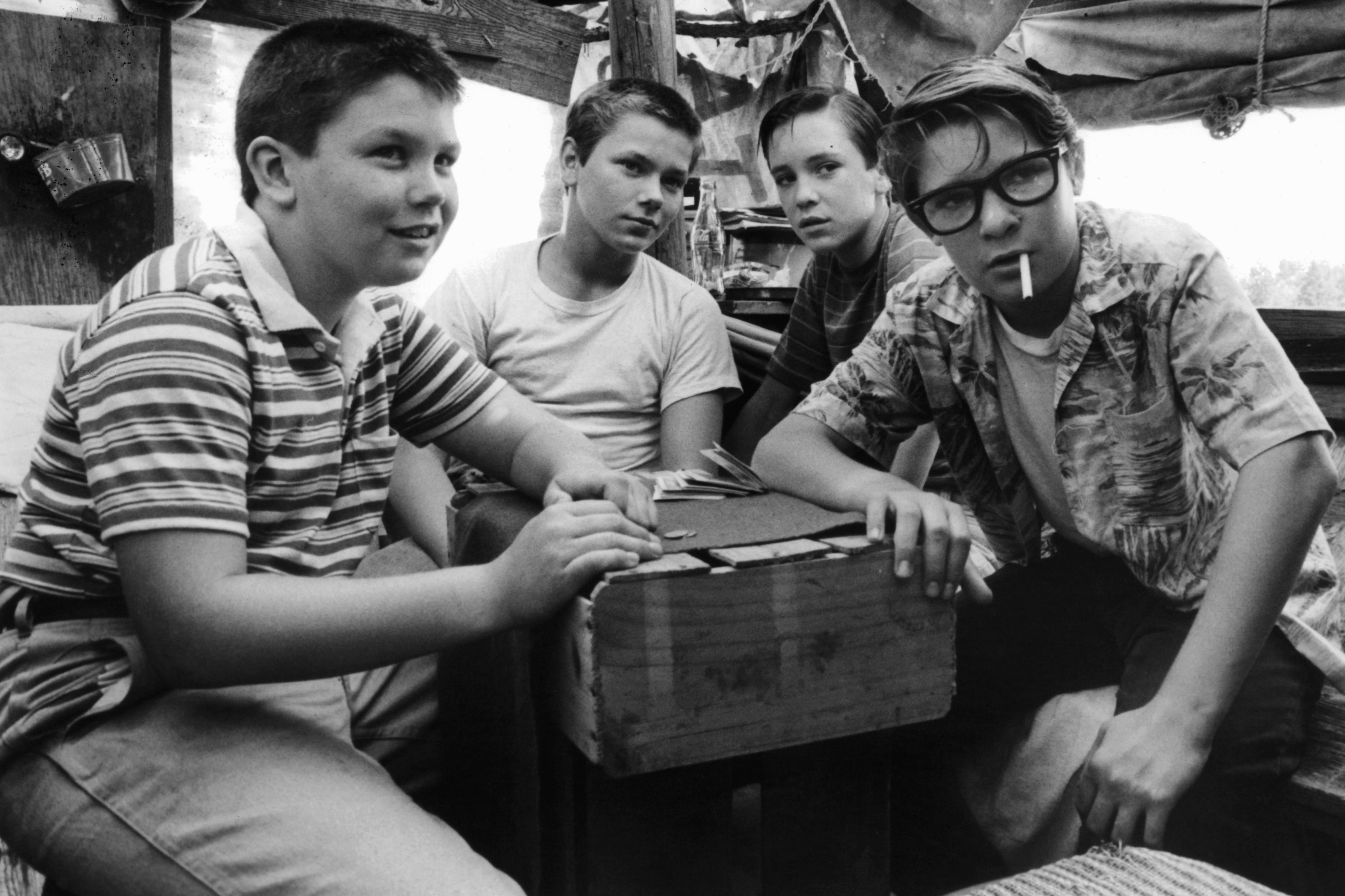 (from L-R) Jerry O'Connell, River Phoenix, Wil Wheaton, and Corey Feldman are gathered around together in a scene from the film Stand By Me (1986).