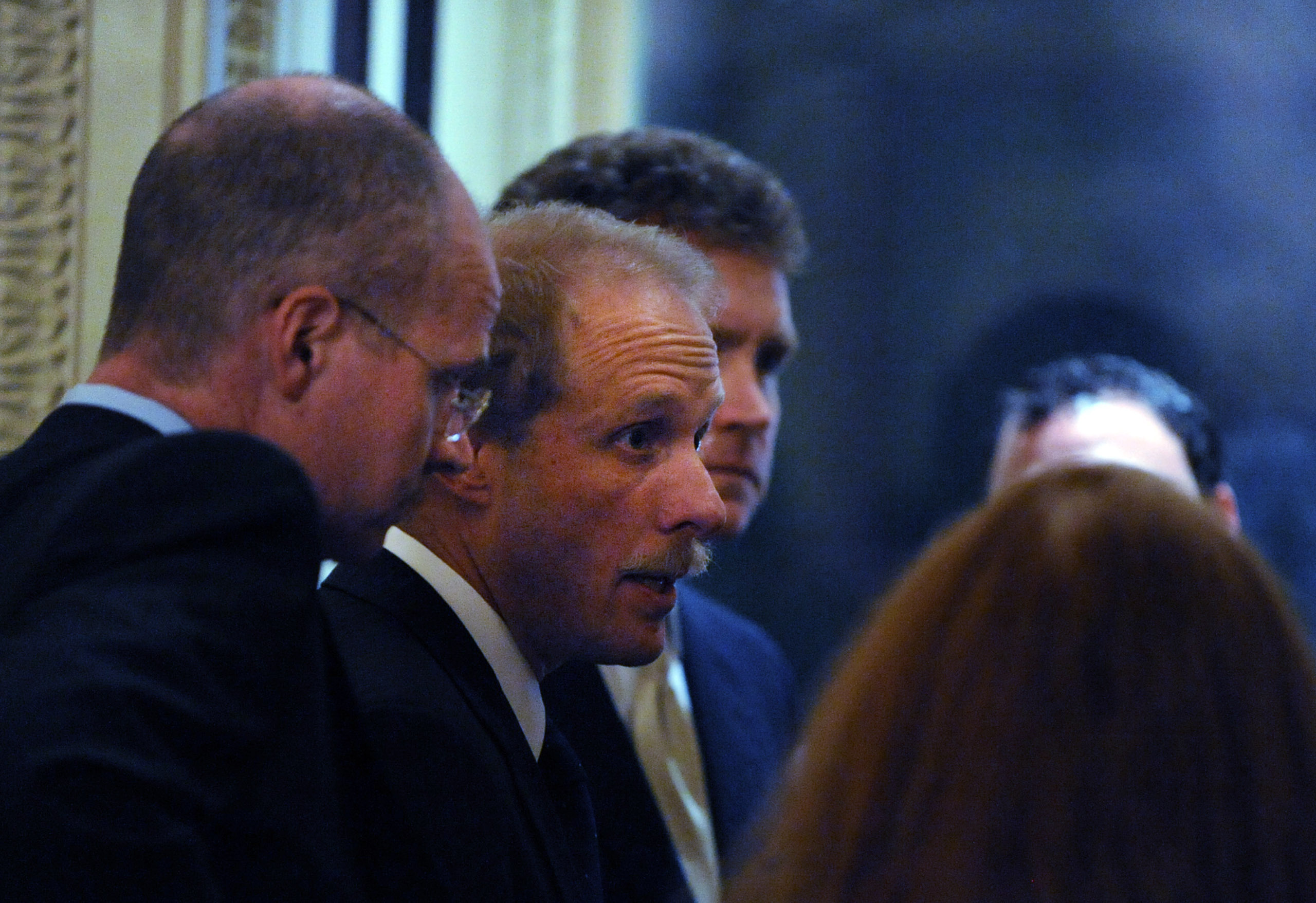 Stephen Feinberg (second from left), a participant in the auto bailout deal, convenes with his crew as lawmakers discuss the auto bailout bill at the US Capitol in Washington in 2008.