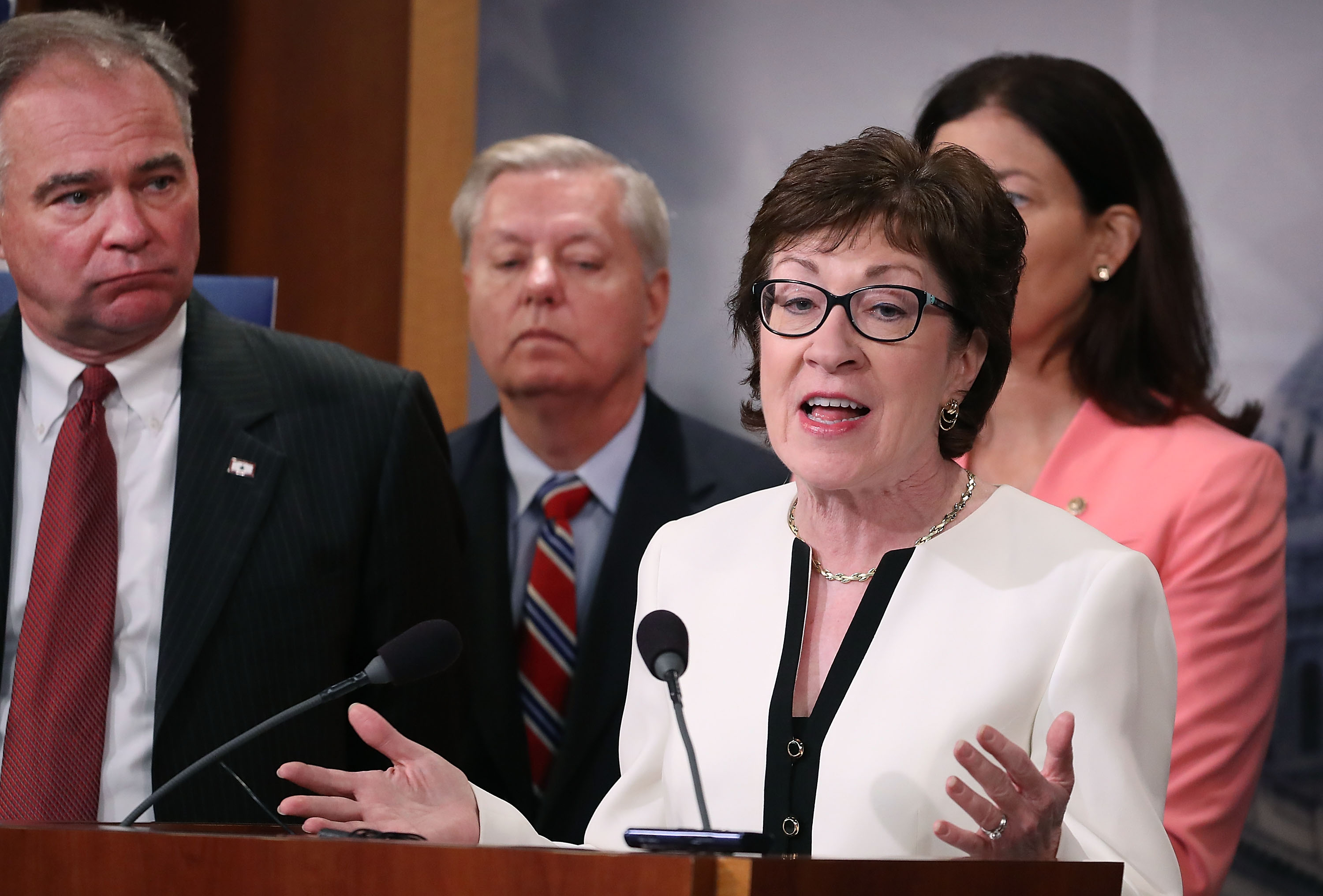Maine Sen. Susan Collins speaks while flanked by bipartisan Senate colleagues during a news conference on Capitol Hill on June 21, 2016 in Washington, D.C.
