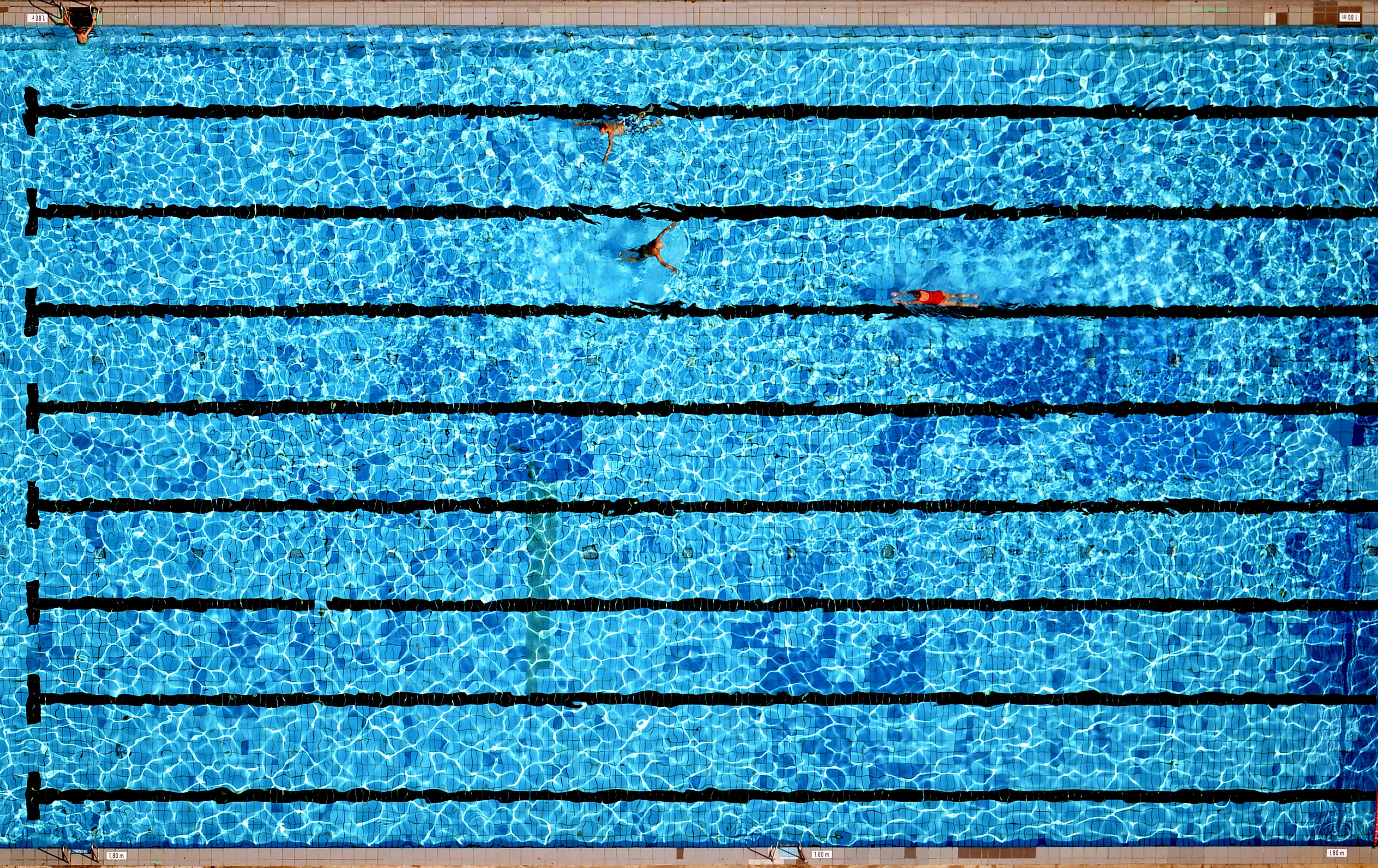 An aerial view shows a swimming pool.