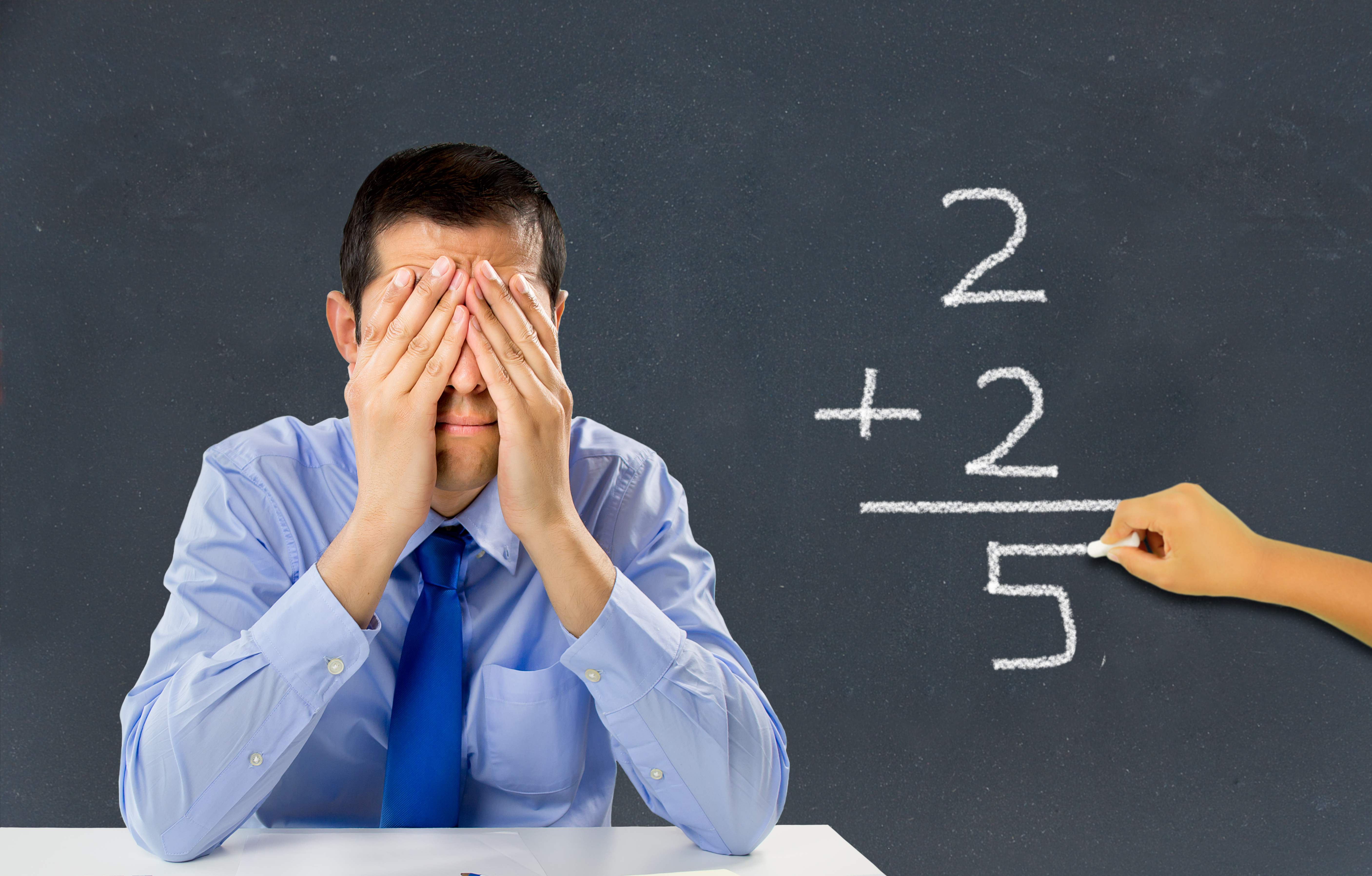 He stressed teacher in a class with a child on the board making a mathematical calculation wrong