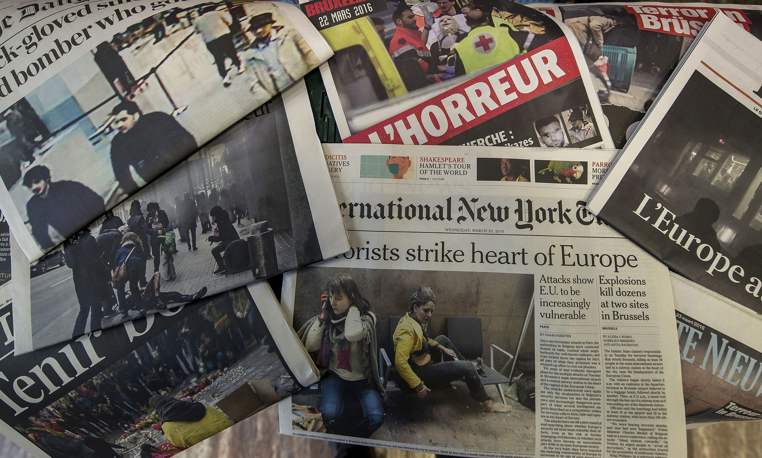 A picture taken on March 23, 2016 in Brussels shows the frontpage of several newspapers, one day after bombings at Zaventem Airport and on a metro train.