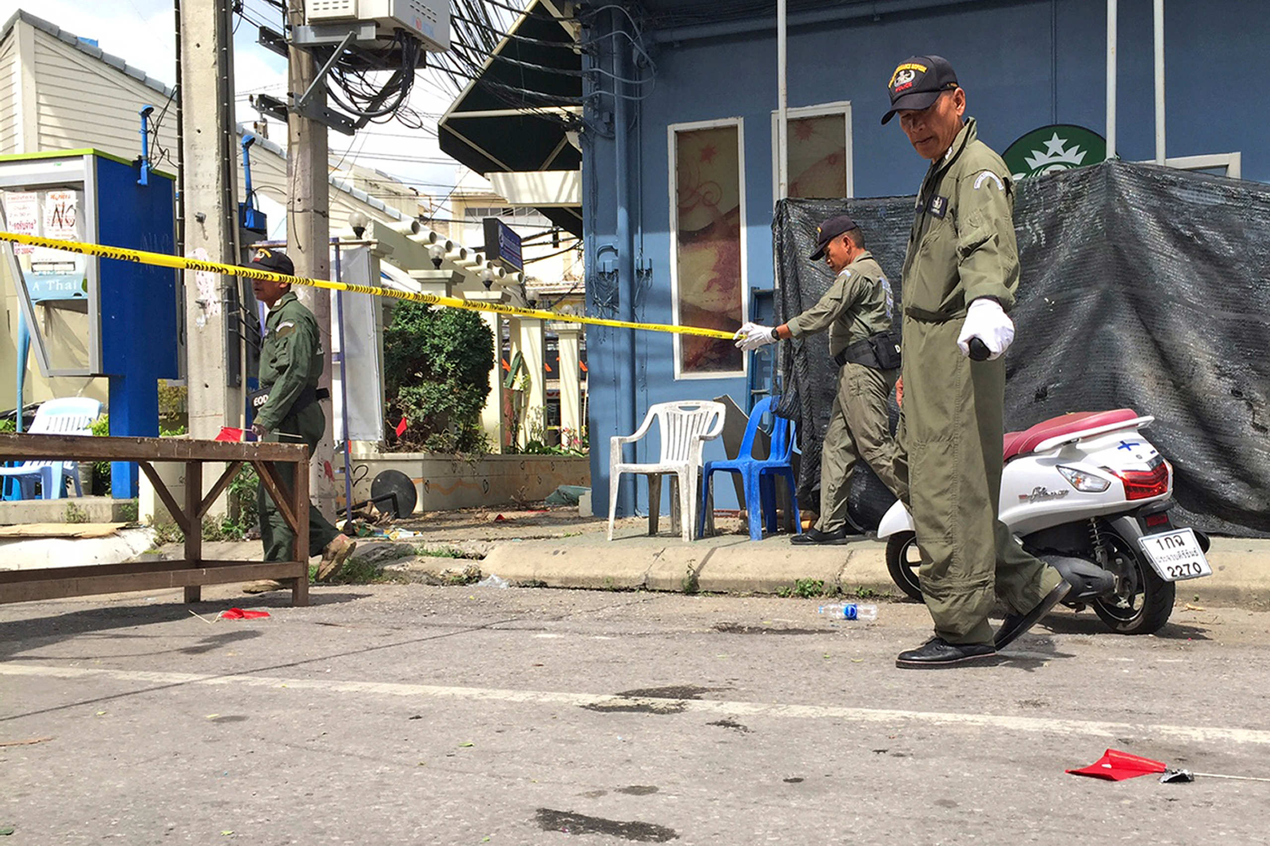 Investigators work at the scene of an explosion in the resort town of Hua Hin, 150 miles south of Bangkok, on Aug. 12, 2016.