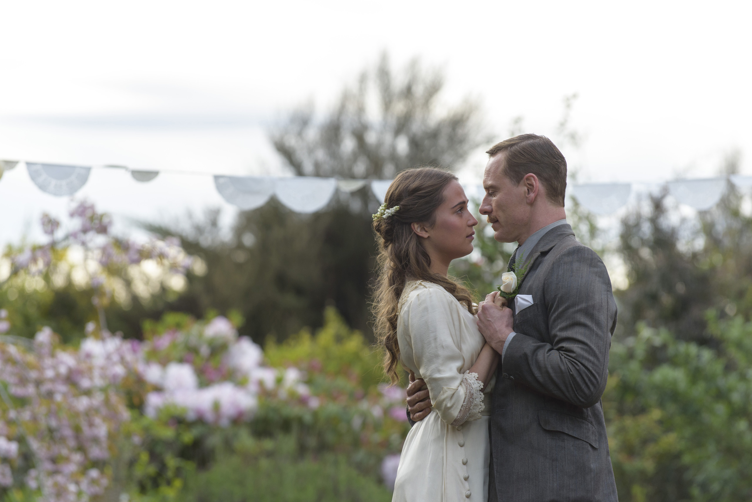 Michael Fassbender stars as Tom Sherbourne and Alicia Vikander as his wife Isabel in DreamWorks Pictures poignant drama  The Light Between Oceans.