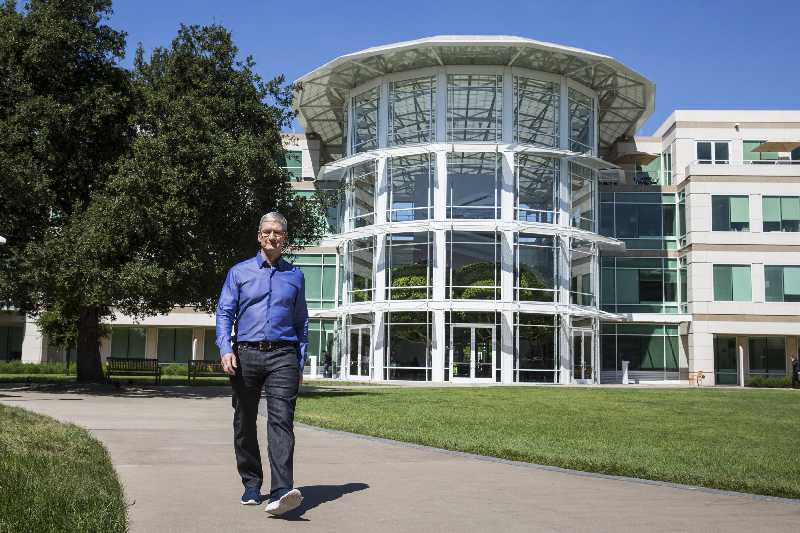 Apple CEO Tim Cook walks through Apple's global headquarters during a photo shoot in Cupertino, Calif. on July 28, 2016.