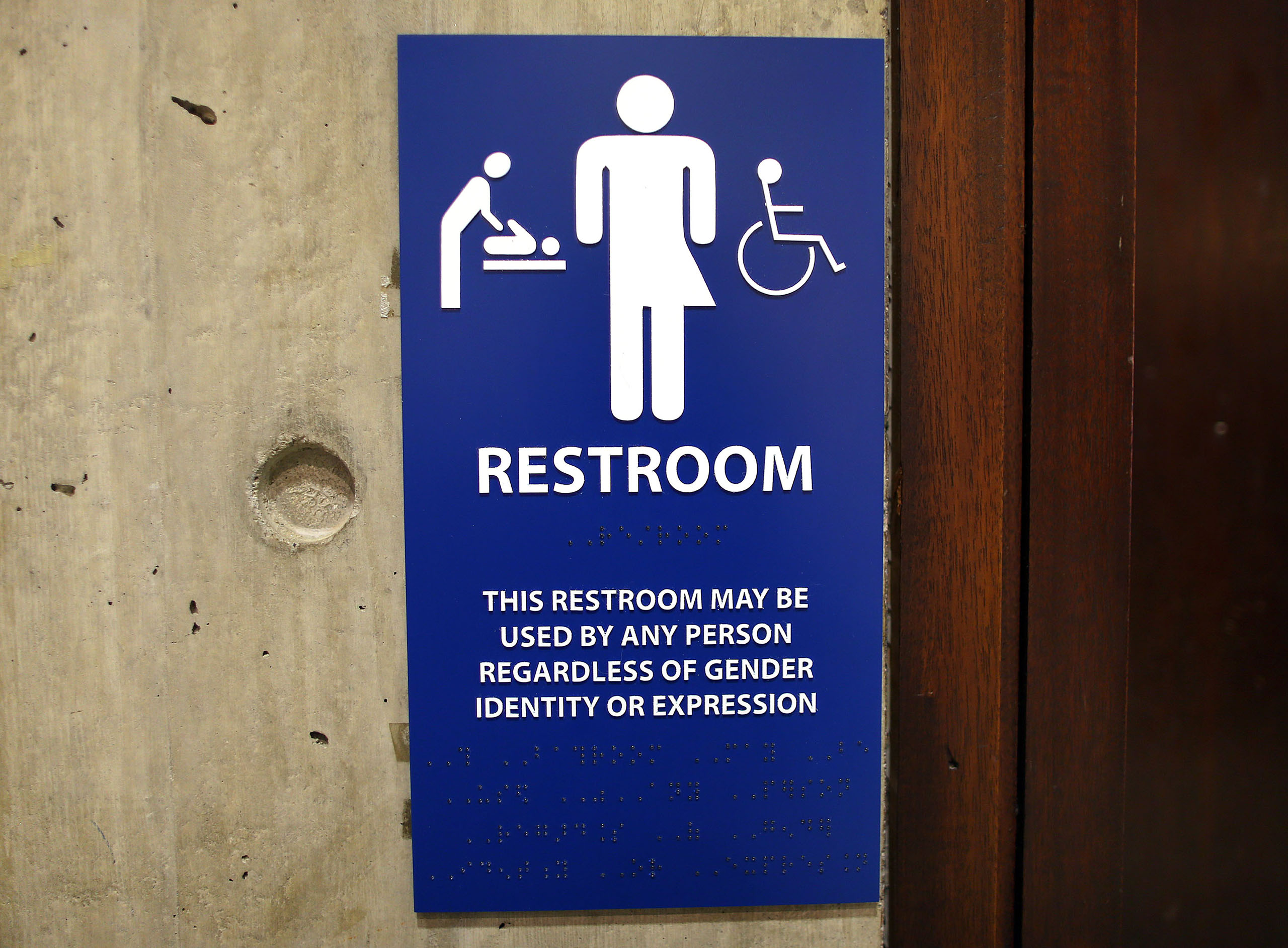 The sign for the gender-neutral bathrooms on the 5th floor of Boston City Hall across from the reception area for the Mayor's office, May 15, 2016.