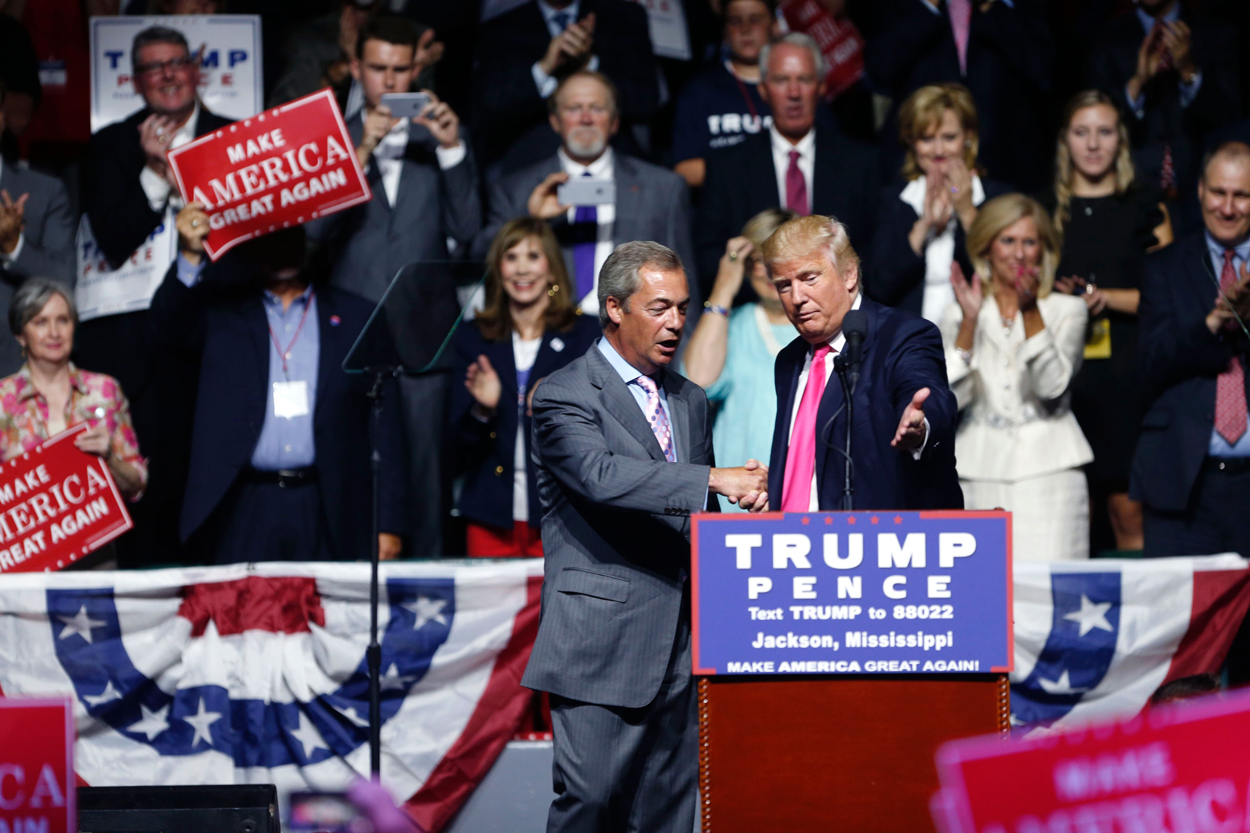 Republican presidential candidate Donald Trump welcomes Nigel Farage, ex-leader of the British UKIP party, to speak at a campaign rally in Jackson, Miss., on Aug. 24, 2016.