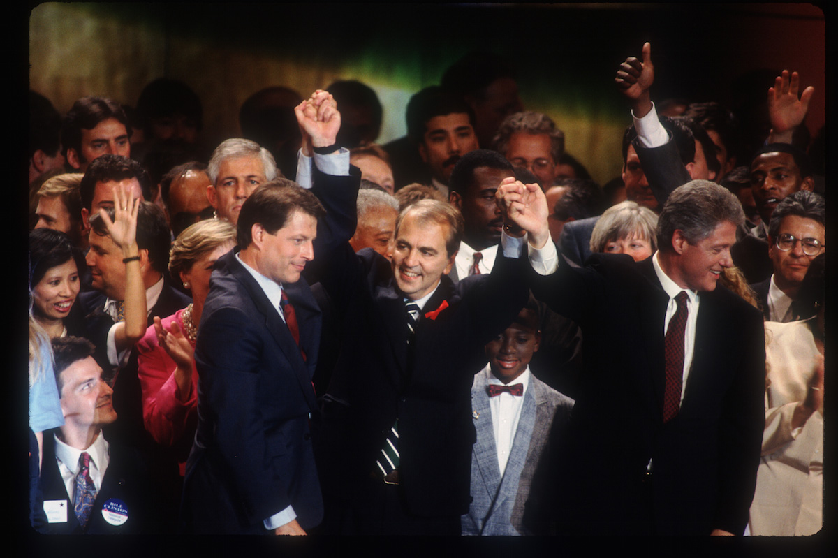 Former senator Paul Tsongas lifts Bill Clinton's and Al Gore's hands July 16, 1992 at the Democratic National Convention in New York City after the Democratic Party nominated Clinton and Gore over Tsongas.