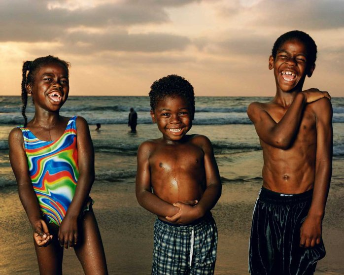 """Abir, Munir, And Sullman Jaffa, 2002. From Testimony Series.""""When I made this photo in 2002 it felt like the beach is where the country came to escape the daily turmoil. This remains one of my favorite images I made at the beach because of the unbridled joy these children exude. A day before I made this image, a suicide bomber killed and injured many people. The innocence and rapture here makes me momentarily forget the reality of what happened down the road."""""""