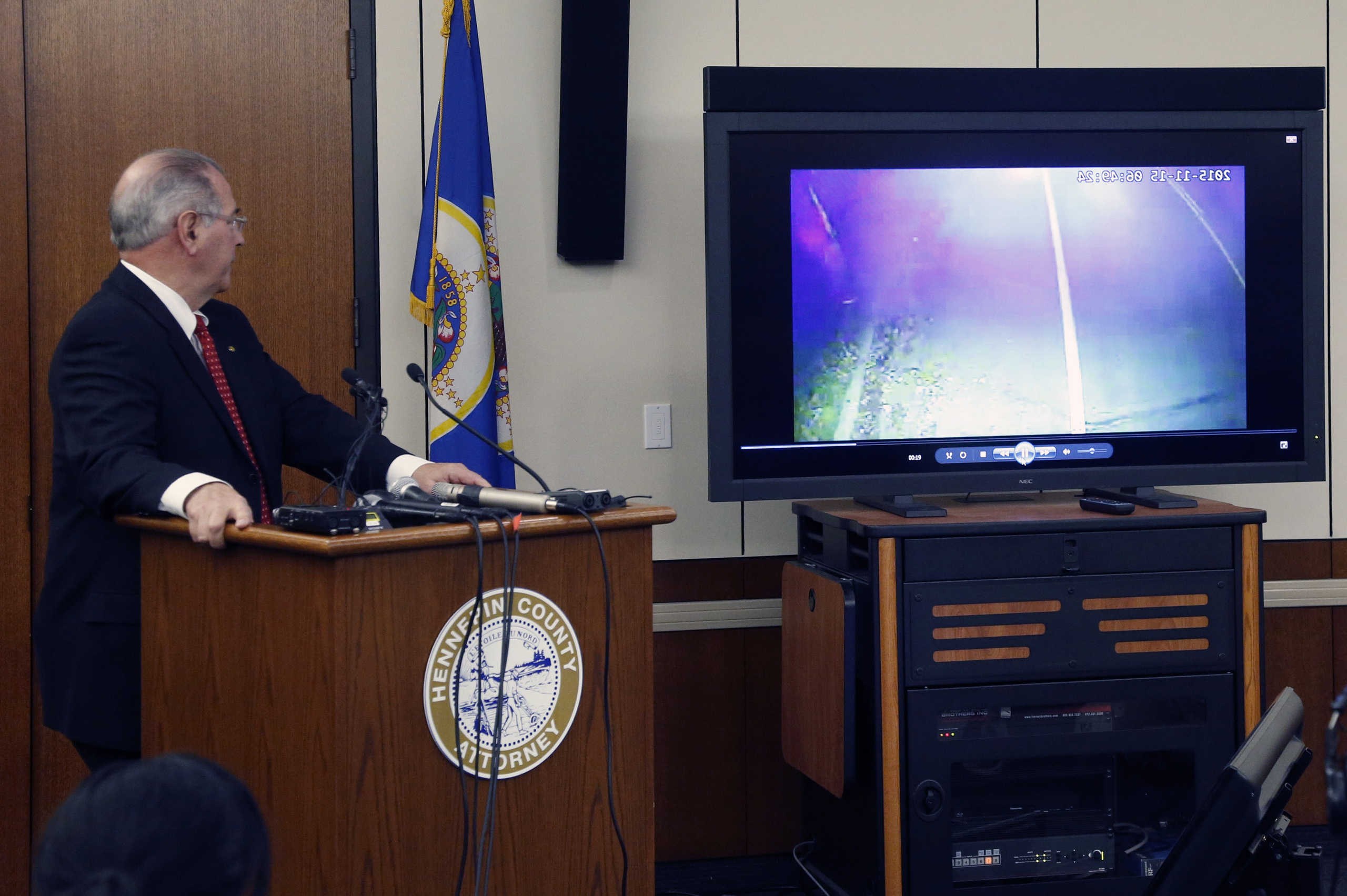 County Attorney Mike Freeman, shows video from evidence after he announced in Minneapolis on March 30, 2016.