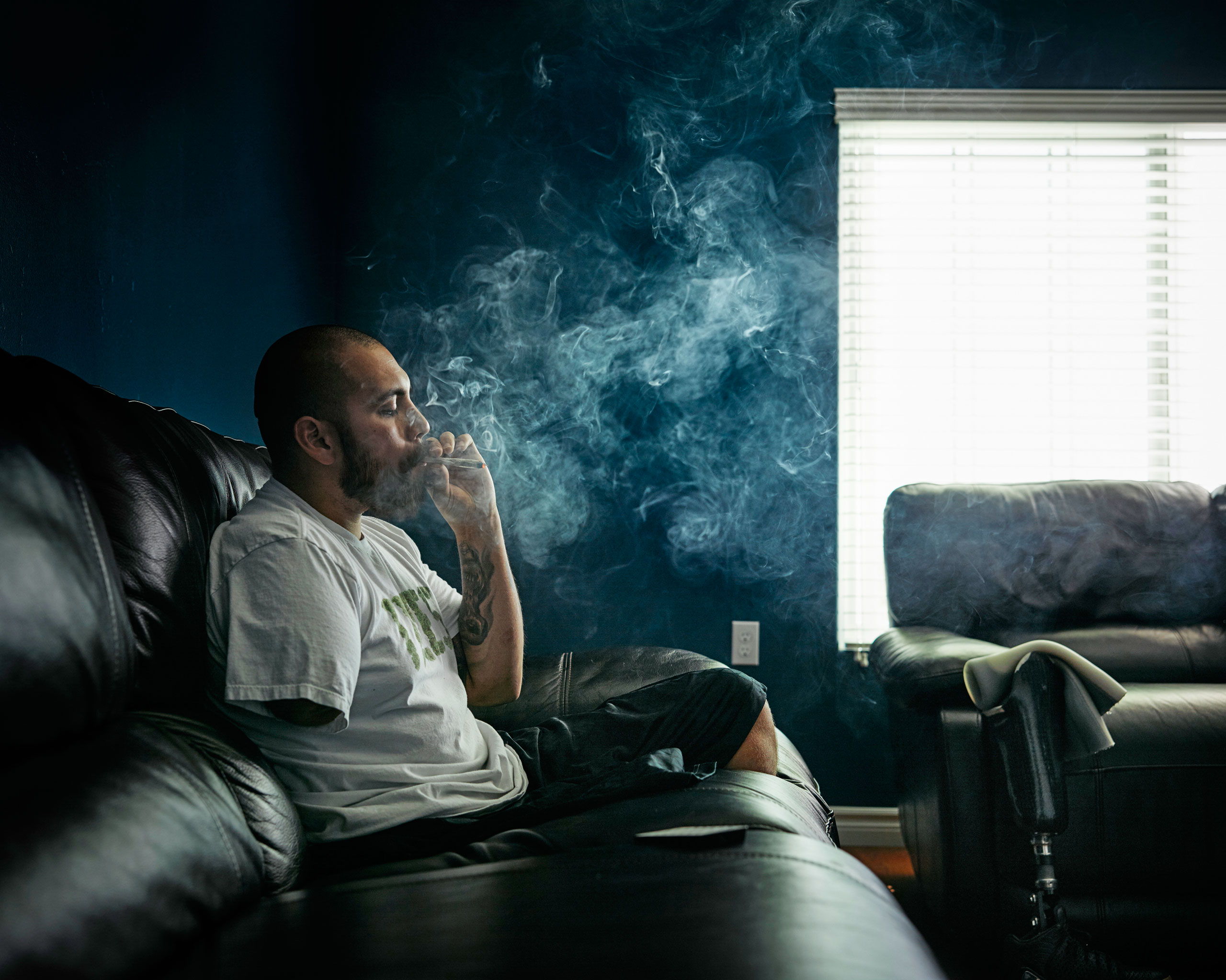 Army veteran                    Jose Martinez smokes marijuana in his California home; he says it eases the PTSD and pain from his 2012 trauma in Afghanistan