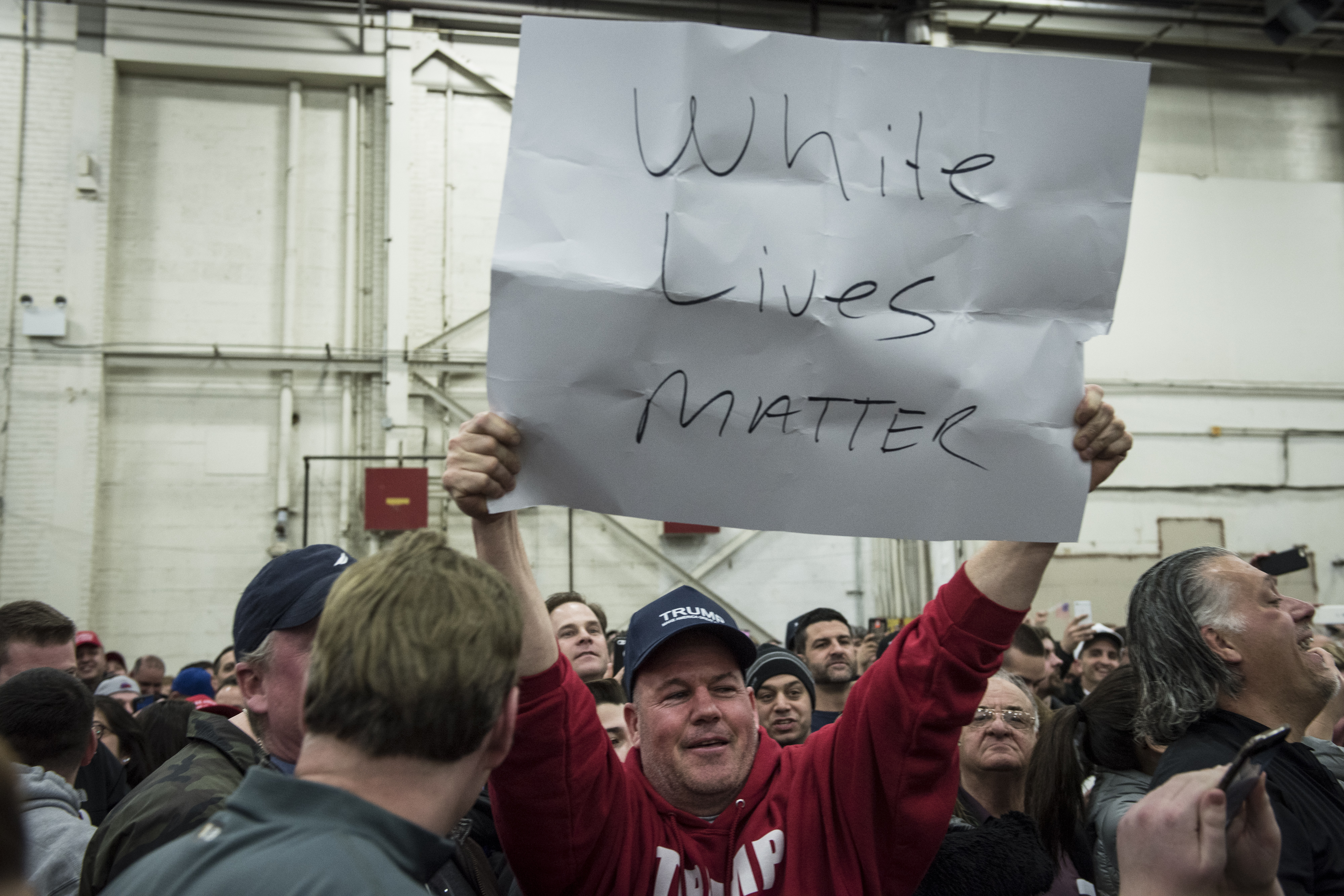 A Trump supporter holds up a  White Lives Matter  sign during a rally for Republican Presidential Candidate Donald Trump on April 6, 2016 in Bethpage, New York. The rally comes ahead of the April 15 New York primary.