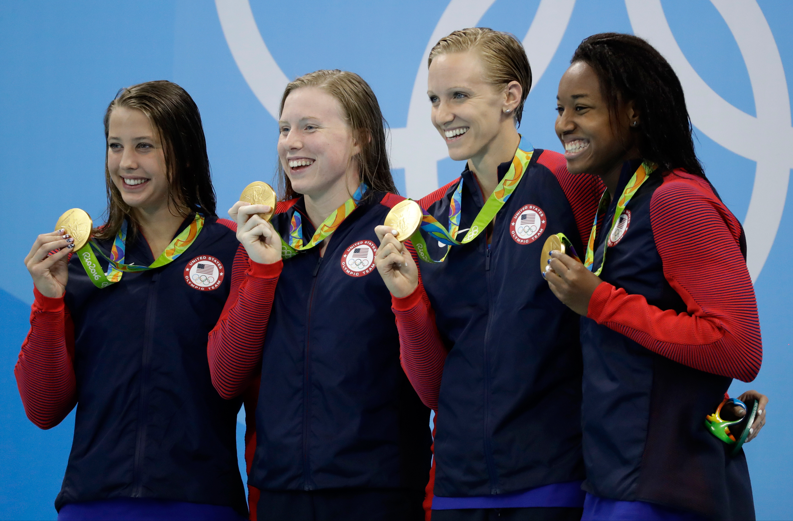 From left to right, United States' Kathleen Baker, Lilly King, Dana Vollmer and Simone Manuel display their gold medals for the women's 4 x 100-meter medley relay final during the swimming competitions at the 2016 Summer Olympics in Rio de Janeiro on Aug. 13, 2016.