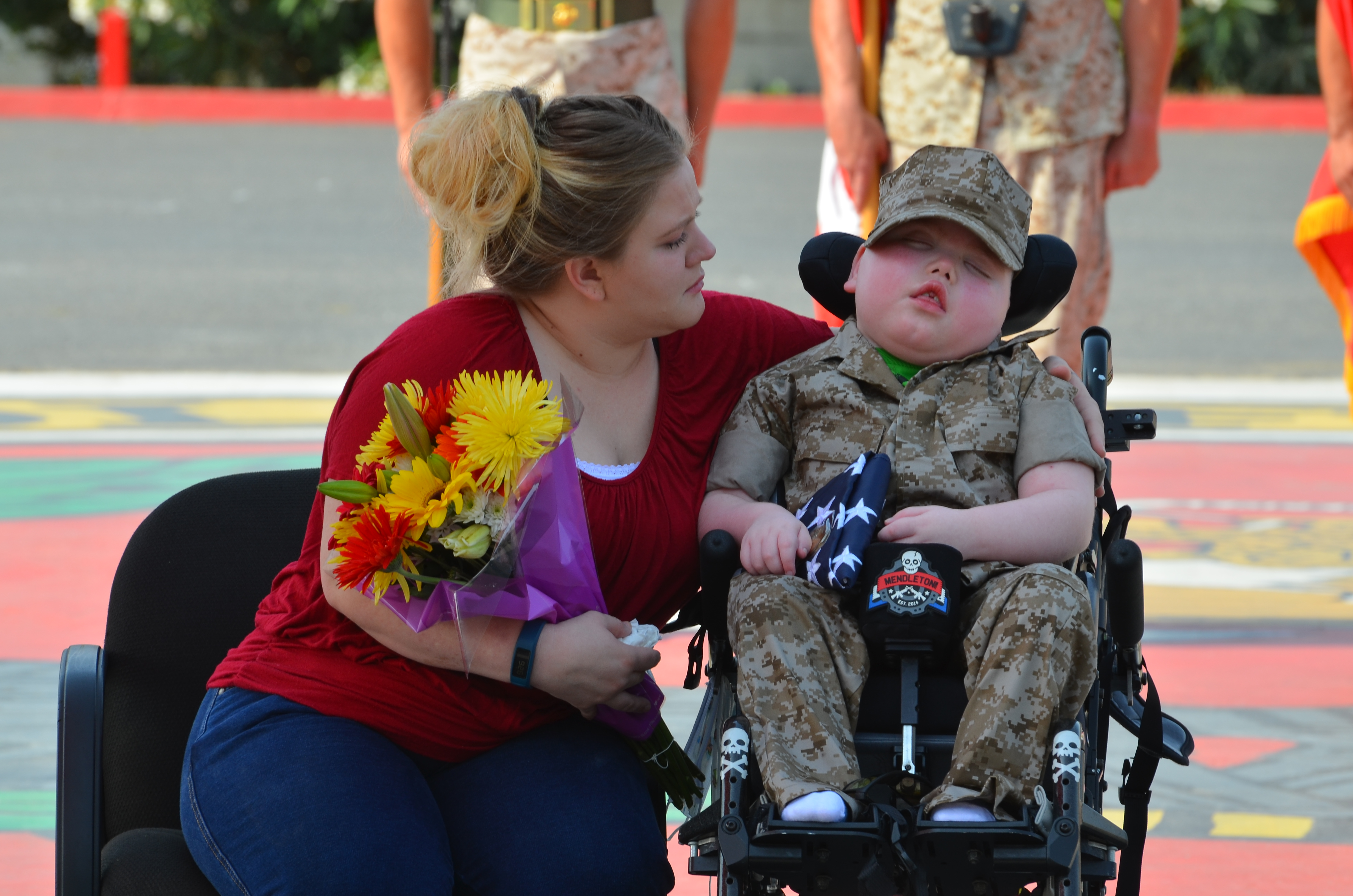 Wyatt Gillette is named an honorary Marine while his mother, Felishia Gillette, sits beside him at a ceremony at the Marine Corps Base Camp in Pendleton, Calif., on July 30.