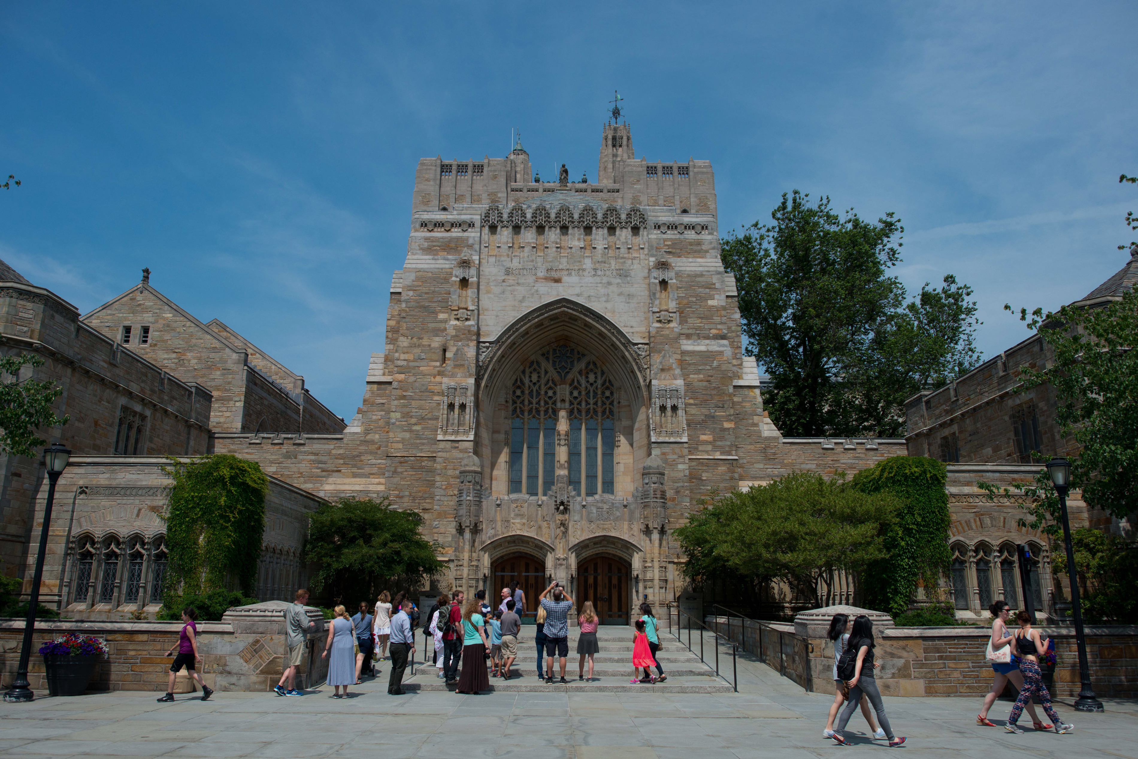 A tour group makes a stop at the Sterling Memorial Library on the Yale University campus in New Haven, Conn., on June 12, 2015.