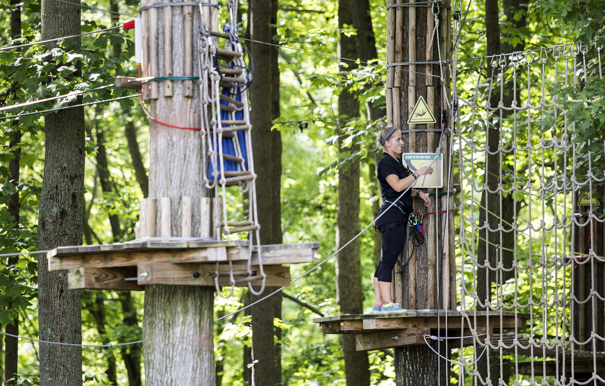 An employee closes up the Go Ape course for the day after a 59 year-old woman fell to her death at the zip line course in Lums Pond State Park in Bear, Del., Wednesday, Aug. 24, 2016.  Jeff Davis, a spokesman for Go Ape, said Thursday, Aug. 25, 2016, that the rides are inspected on a regular basis. Davis said the Lums Pond attraction is closed for undetermined amount of time to help with the investigation,  and also in respect to the family of the person who died.   The Go Ape company is extremely saddened by this,  he said. (Kyle Grantham/The Wilmington News-Journal via AP)