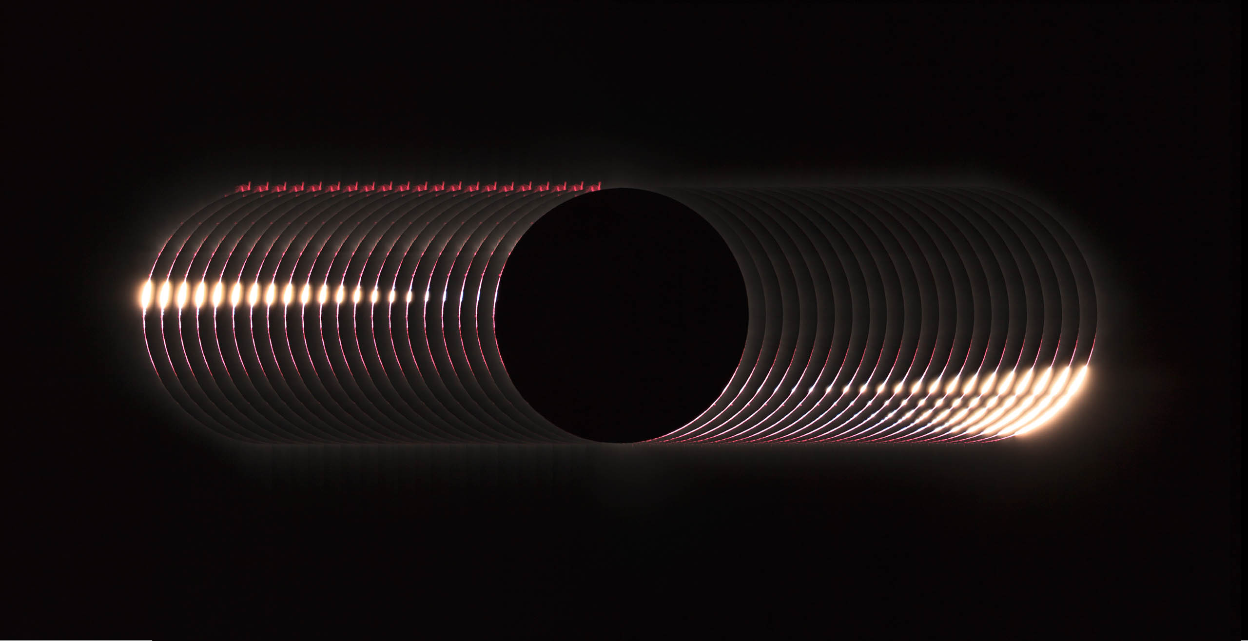 Our Sun and Overall Winner: The Baily's beads effect is a feature of total solar eclipses. As the moon  grazes  by the Sun during a solar eclipse, the rugged lunar topography allows beads of sunlight to shine through in some places, and not in others.  I took a series of photos of the total solar eclipse of 2016, in Luwuk Indonesia, and stacked them to show the baily's beads' dramatic changes,  writes Photographer Yu Jun.
