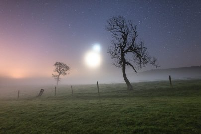 "Skyscapes:Ainsley Bennet captured this image of Venus and the crescent Moon on a misty morning on the Isle of Wight in October. The image ""looked like something from a science fiction movie, with Binary stars rising from the horizon of an unknown planet,"" he writes."