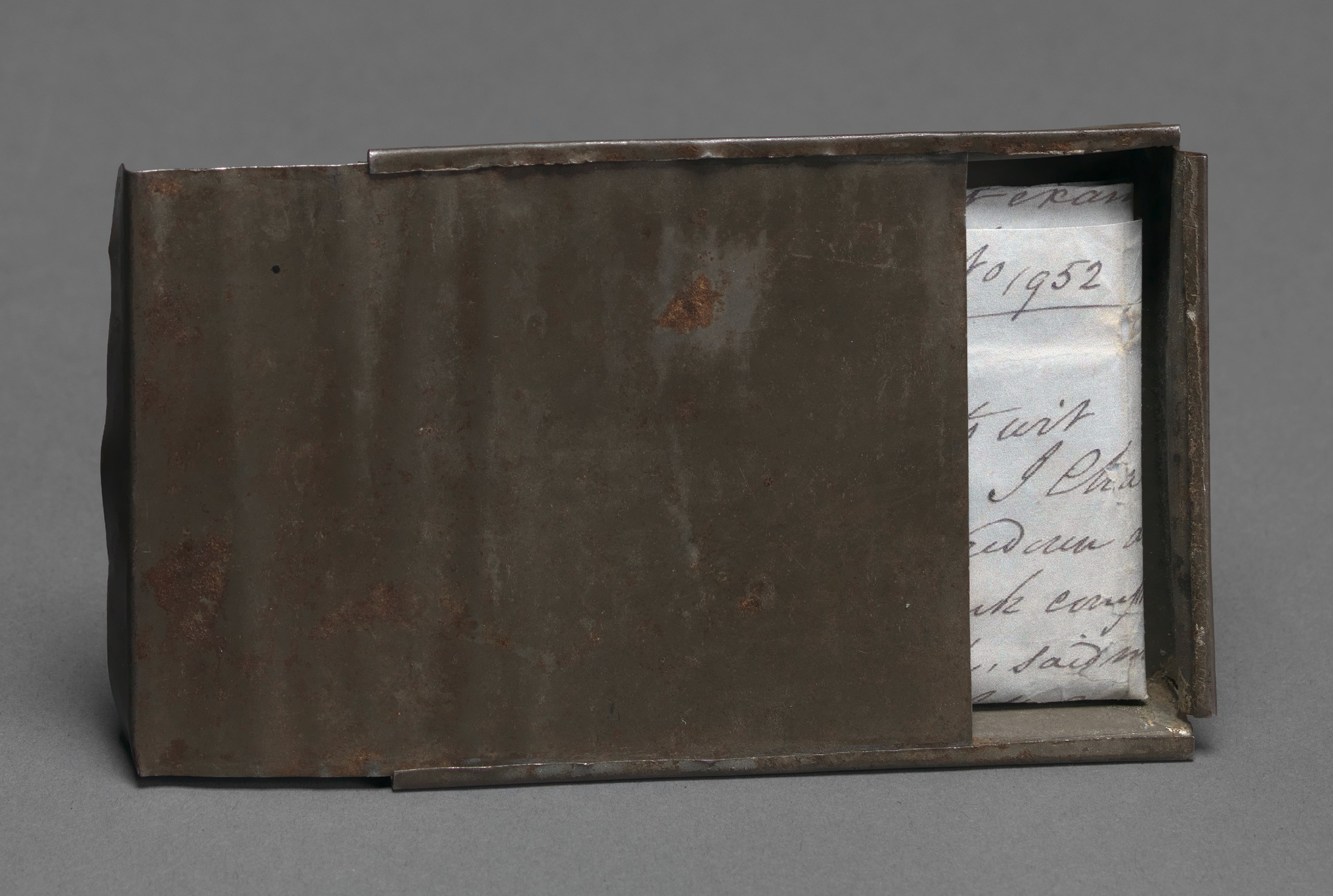Tin box handmade and carried by Joseph Trammell to hold freedom papers, 1852.