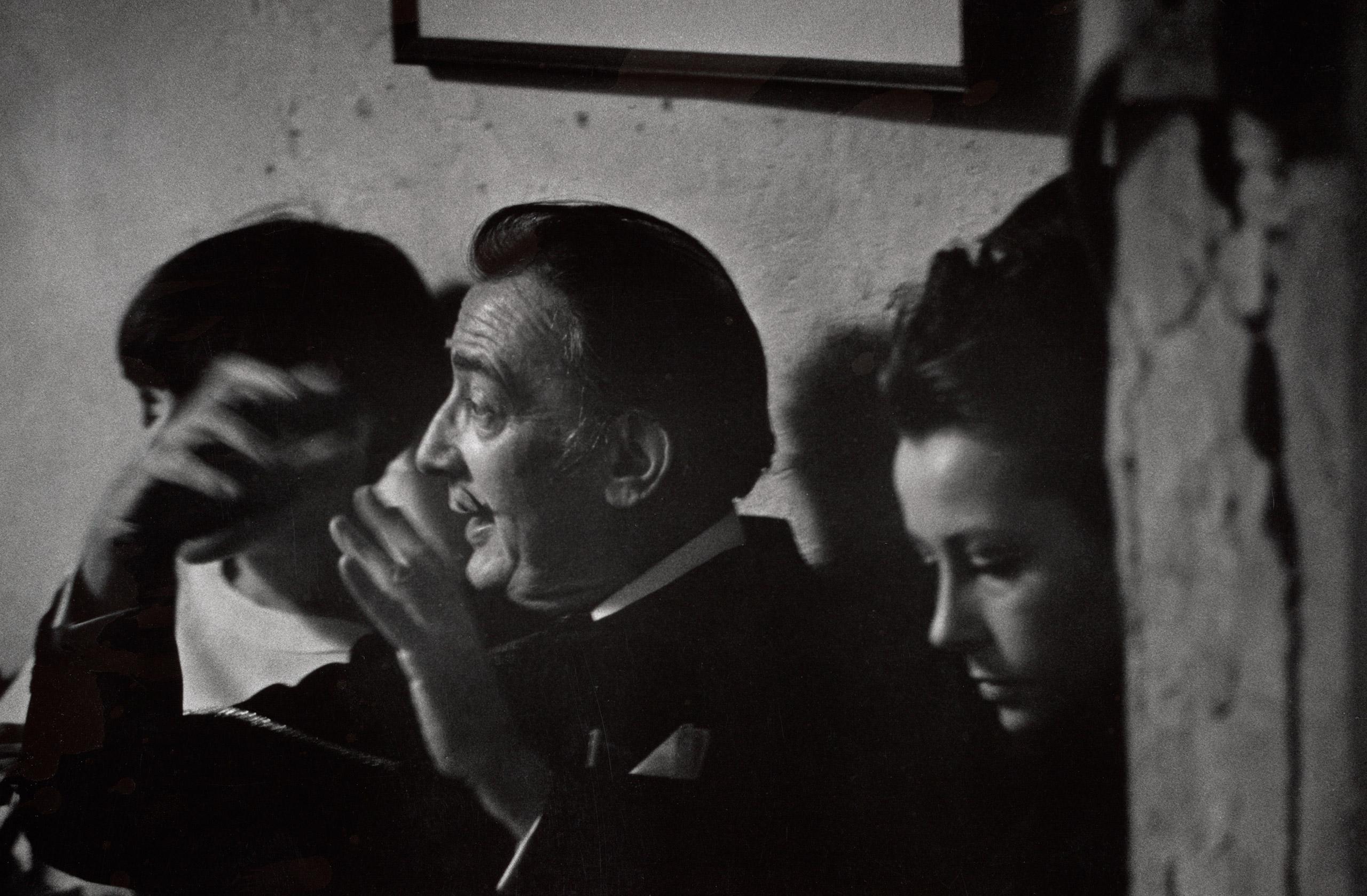 Salvador Dali and Ultra Violet at a loft party, c. 1960s.