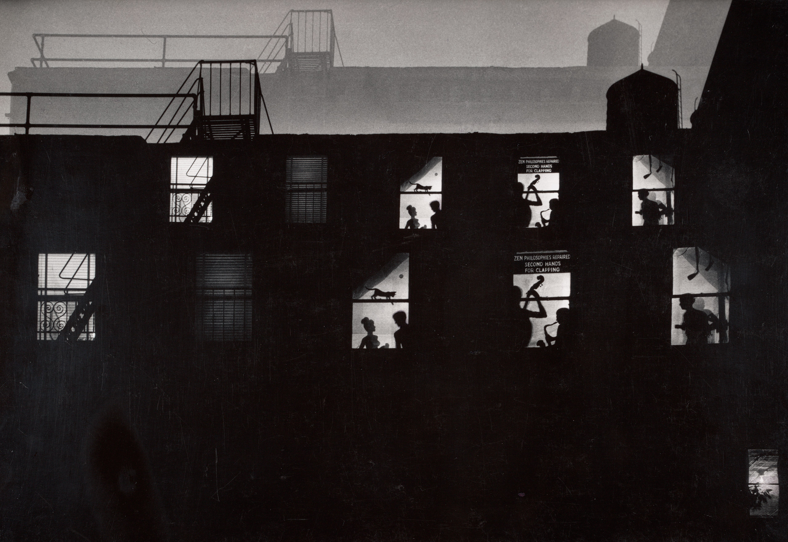 An experimental loft photo with added cut-out silhouettes in the windows.