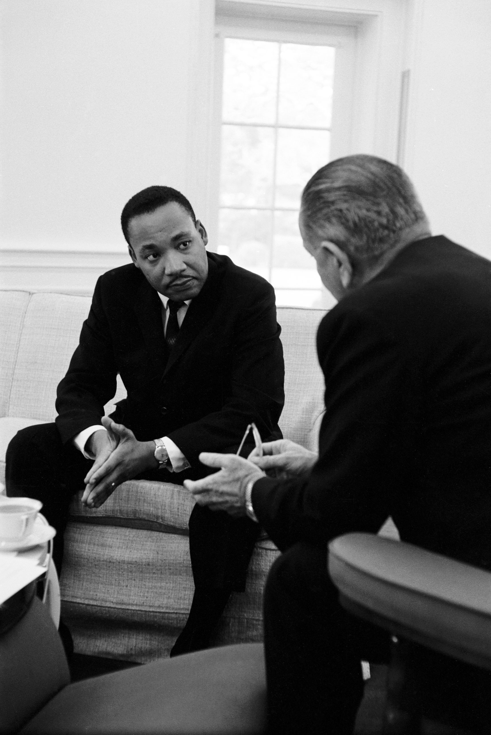 Civil rights leader Dr. Martin Luther King speaking with President Lyndon Johnson during a visit to the White House.