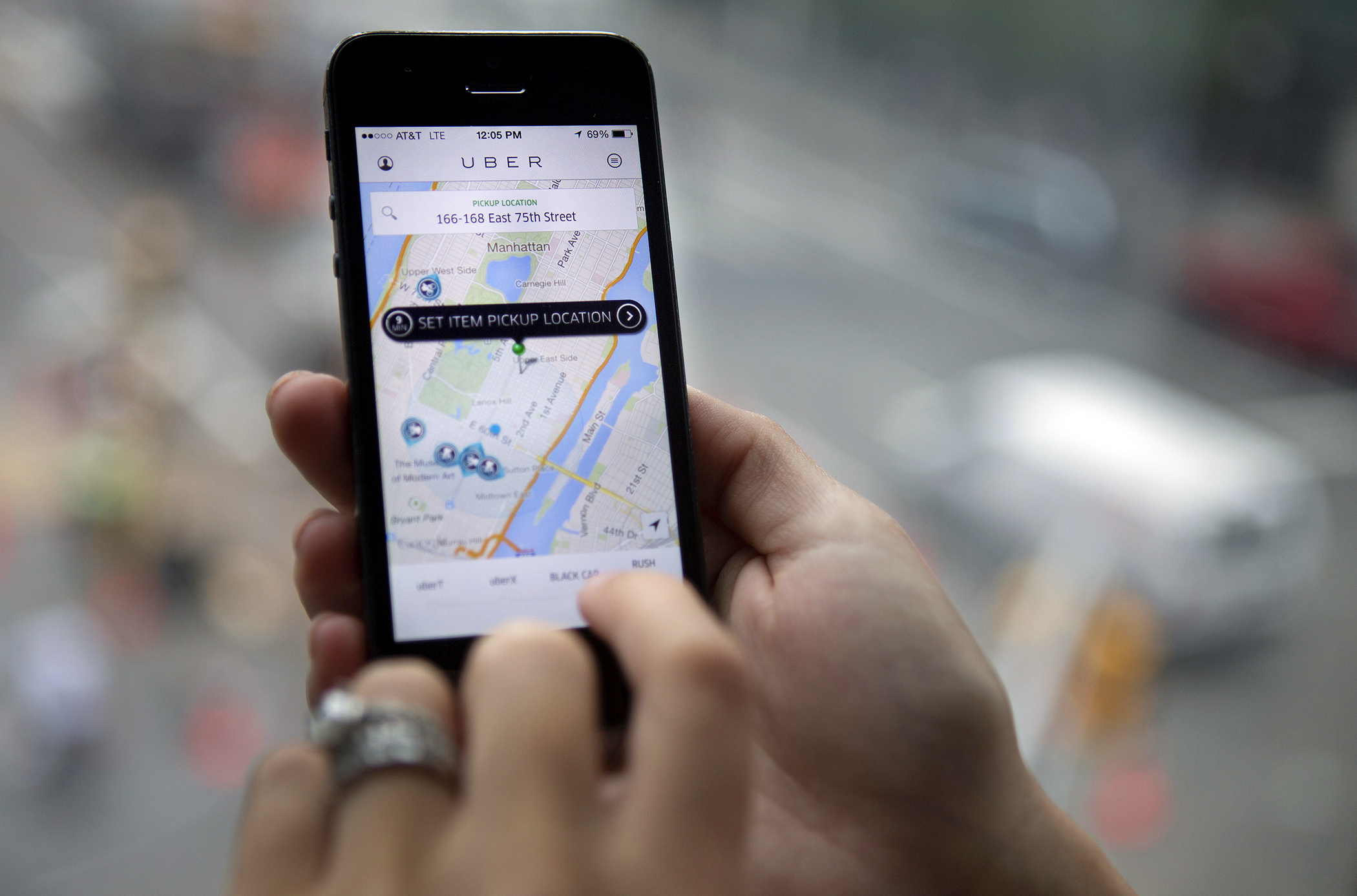 The Uber Technologies Inc. car service application (app) is demonstrated for a photograph on an Apple Inc. iPhone in New York, on Wednesday, Aug. 6, 2014.