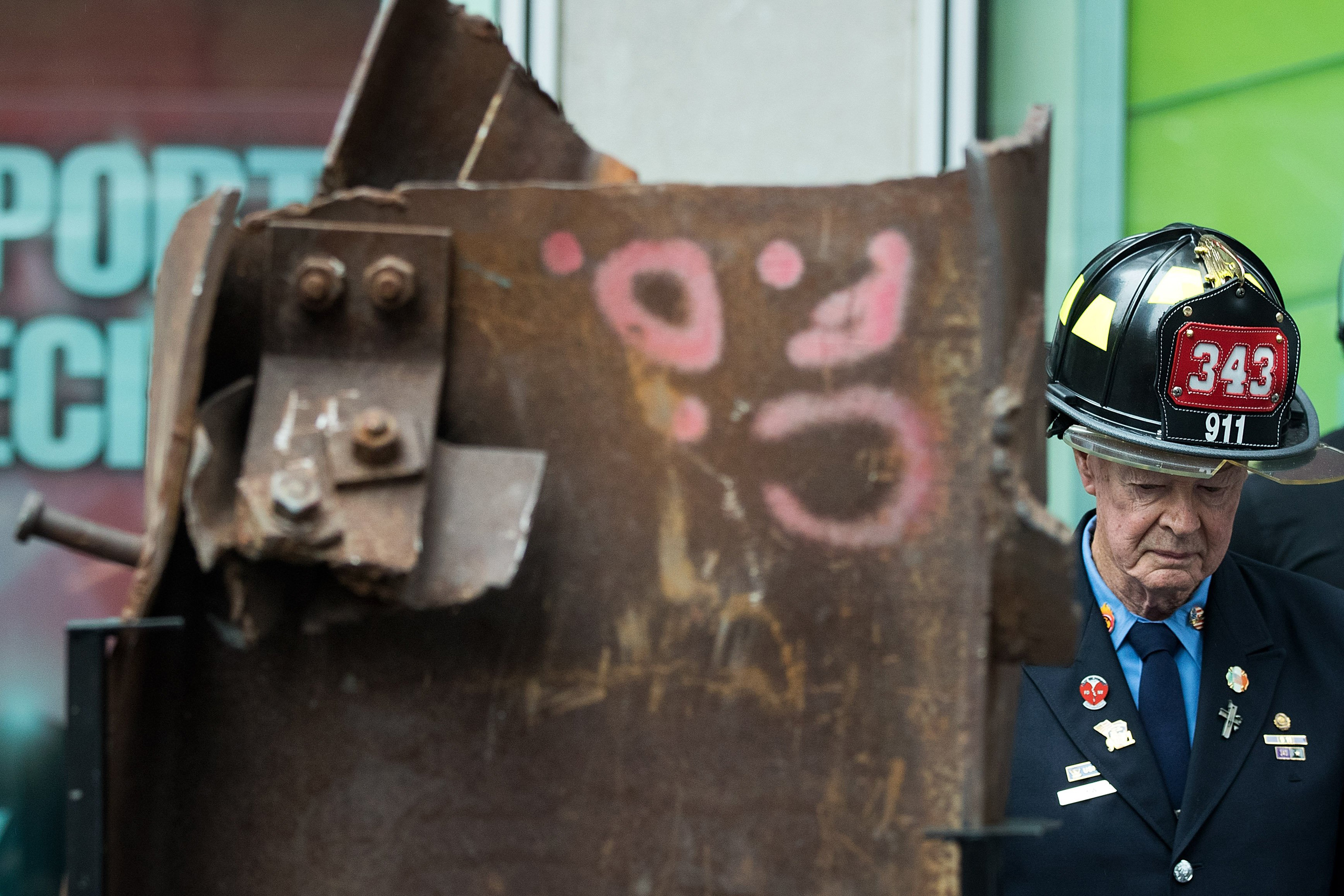Bob Beckwith, retired firefighter who stood next to President George W. Bush at ground zero, stands next to a piece of steel from the World Trade Center, during a ceremony outside the Fox News studios to mark the beginning of the piece of steel's journey from New York City to Gander, Newfoundland in Canada, in New York City on Sept. 6, 2016.