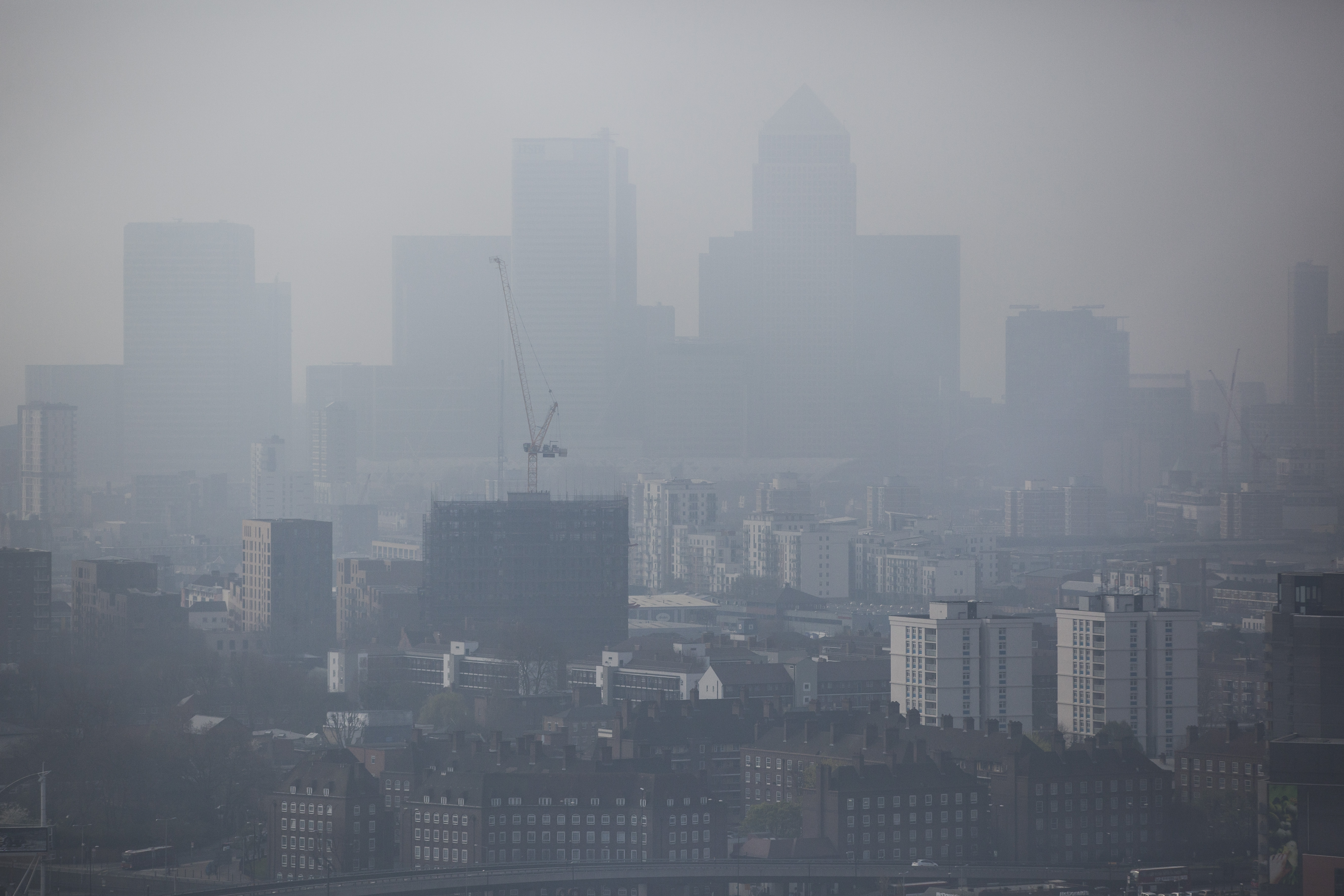 A general view through smog of the Canary Wharf financial district on April 2, 2014 in London, England.