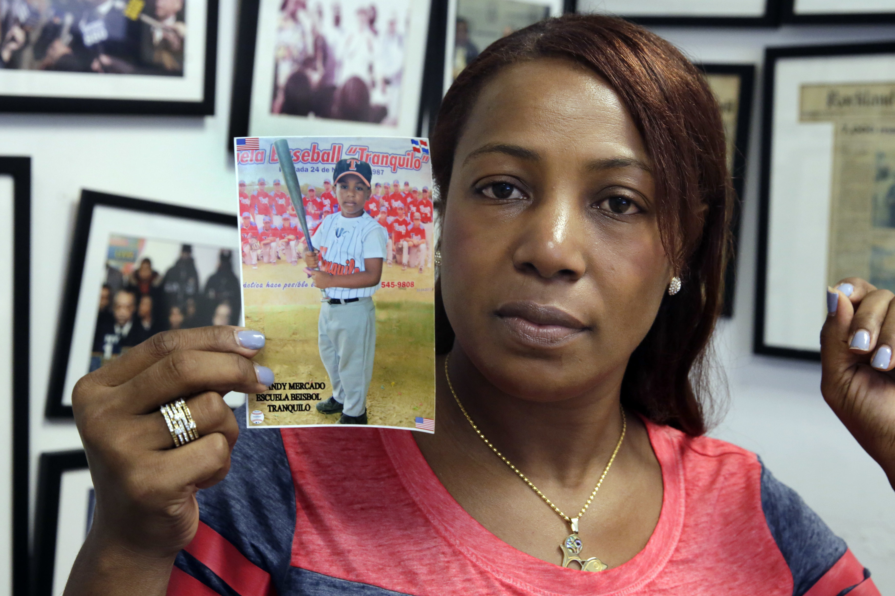 Maribel Martinez holds a photo of her son Andy at her attorney's office, in the Brooklyn borough of New York, Thursday, Sept. 1, 2016. Martinez says she hasn't stopped crying since JetBlue airlines mistook her 5-year-old for another child and flew him to the wrong city.
