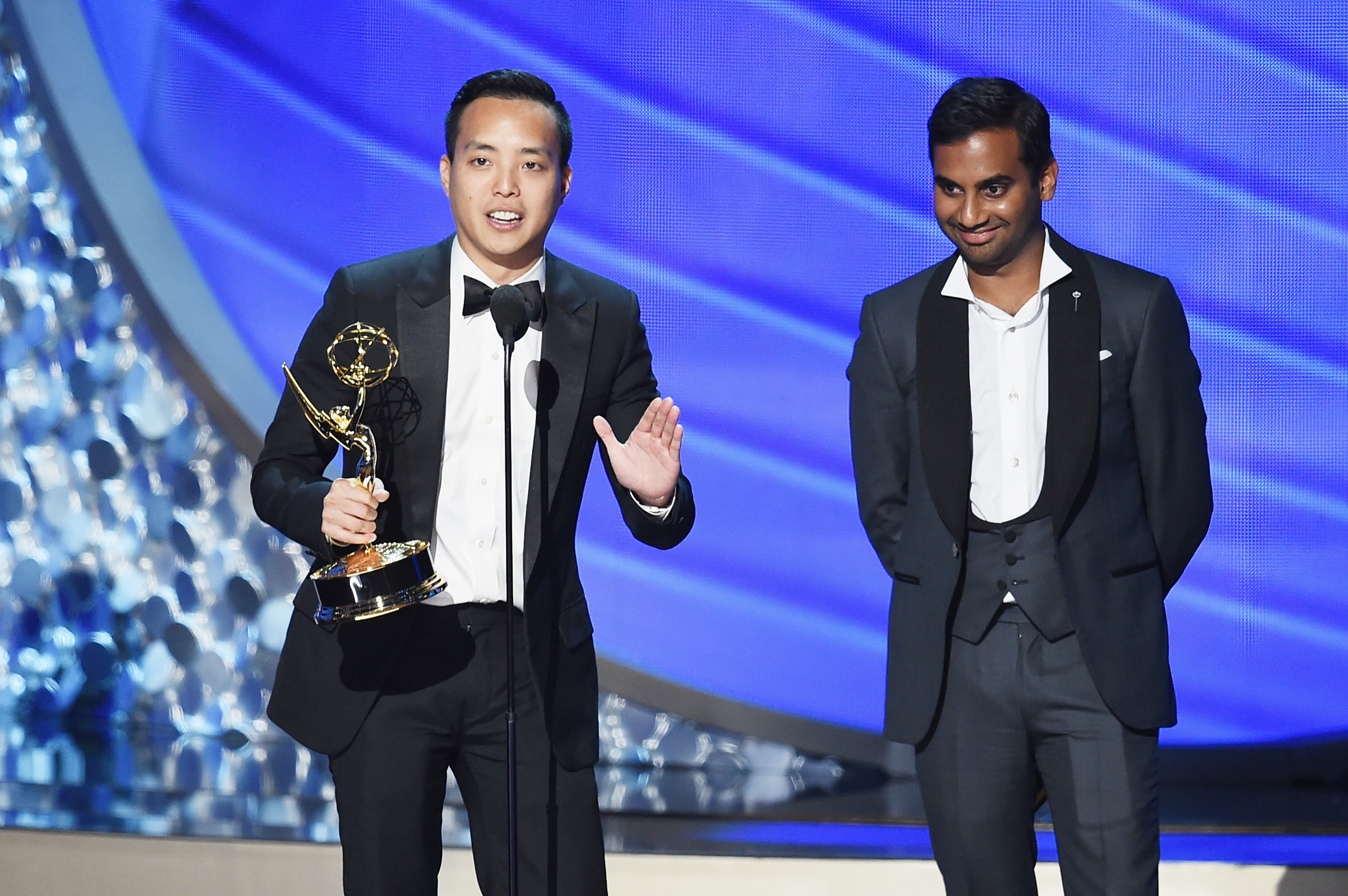 Alan Yang, left, and Aziz Ansari accept Outstanding Writing for a Comedy Series for the Master of None episode  Parents  during the 68th Annual Primetime Emmy Awards on Sept. 18, 2016, in Los Angeles