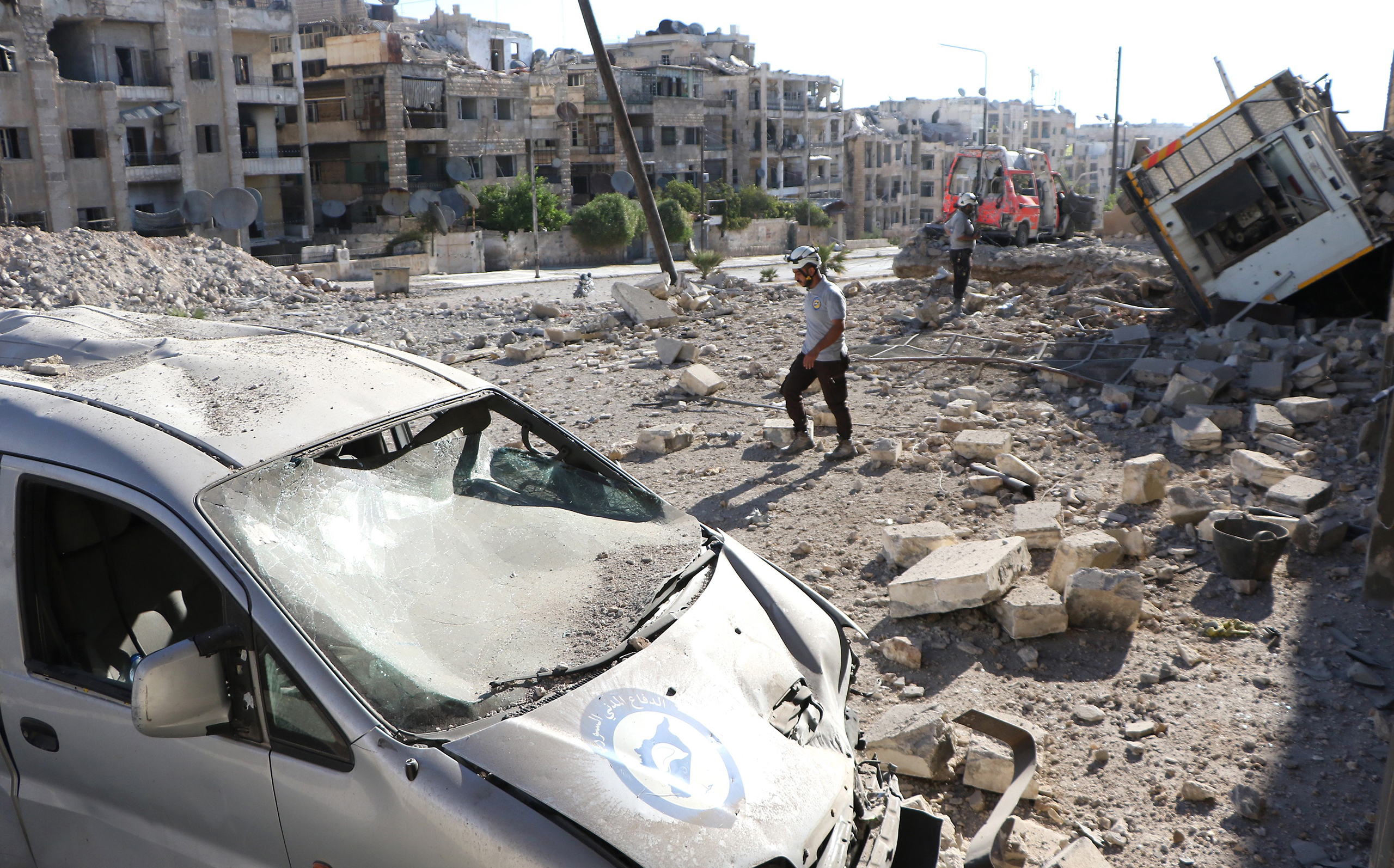 Debris of buildings and destroyed vehicles are seen after suspected Russian warplanes hit the civil defense center at Al-Ansari, in the rebel-held section of Aleppo, Syria, on Sept. 23, 2016.
